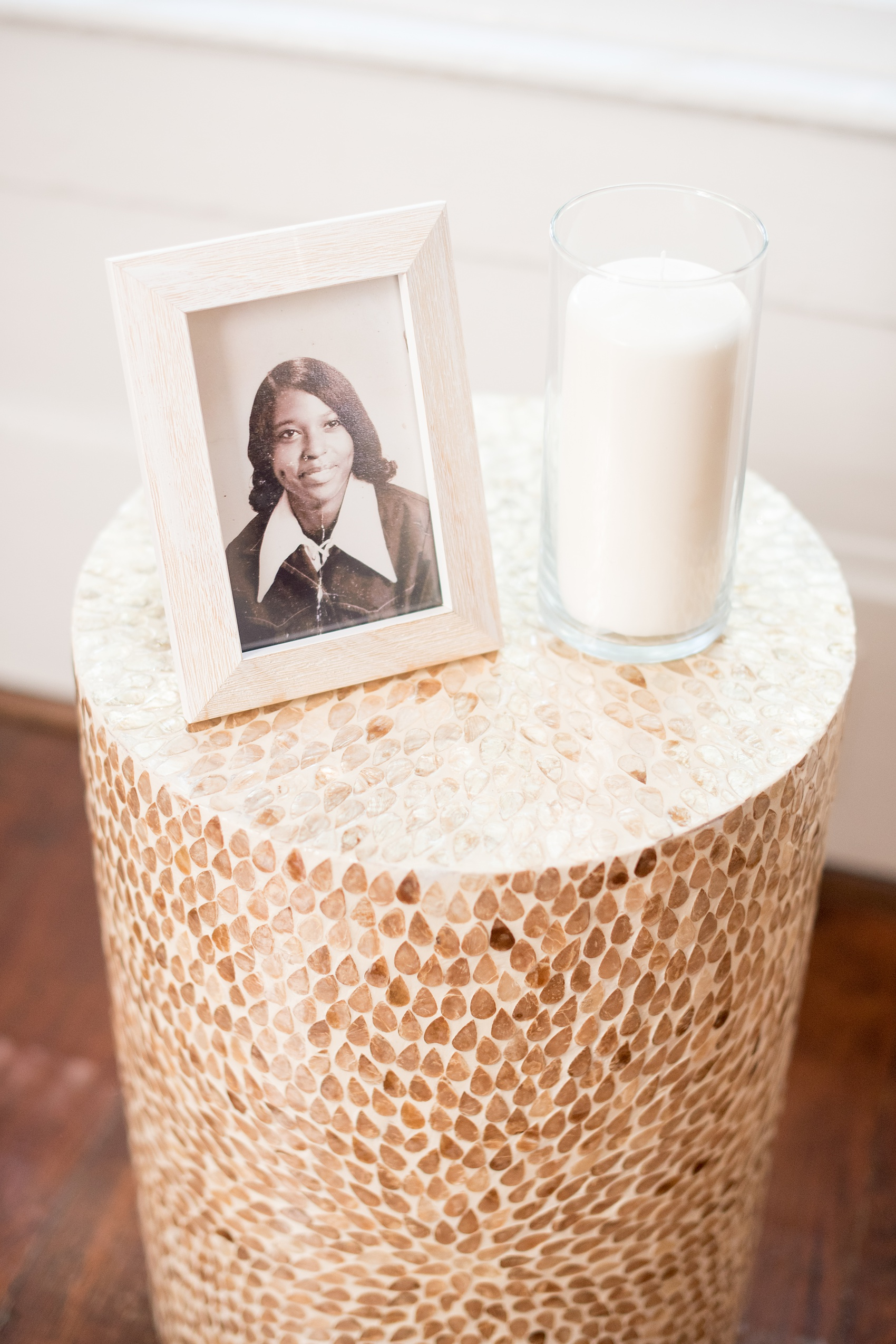 Mikkel Paige Photography pictures of a wedding at Leslie-Alford Mim's House in North Carolina for a Mad Dash Weddings event. Photo of the groom's mother's photo and remembrance candle on a side table in the ceremony room.