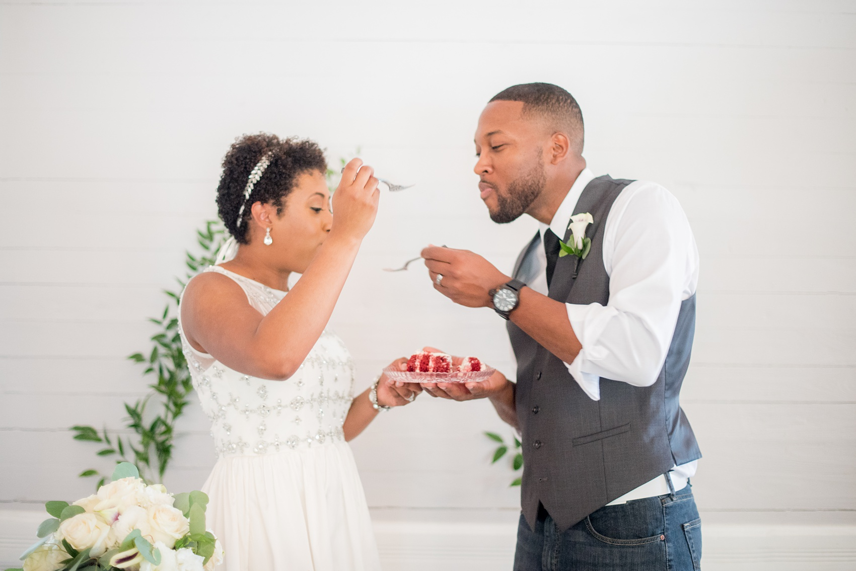 Mikkel Paige Photography pictures of a wedding at Leslie-Alford Mim's House in North Carolina for a Mad Dash Weddings event. Photo of the couple's cake cutting and red velvet cake.