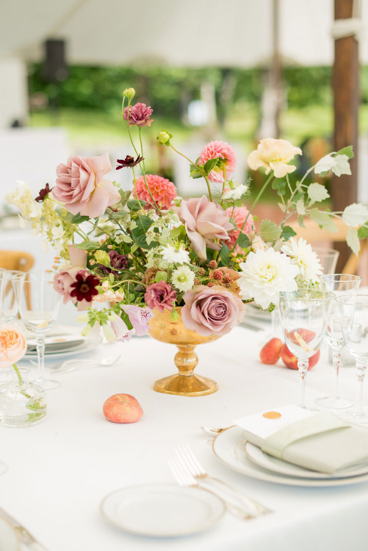 Mikkel Paige Photography photos from a Southwood Estate Wedding in Germantown, New York in the Hudson Valley. Picture of the centerpieces on a table with flowers including mauve, dusty rose, burgundy, lavender,and pink roses, dahlias, spray roses, peaches and berries.