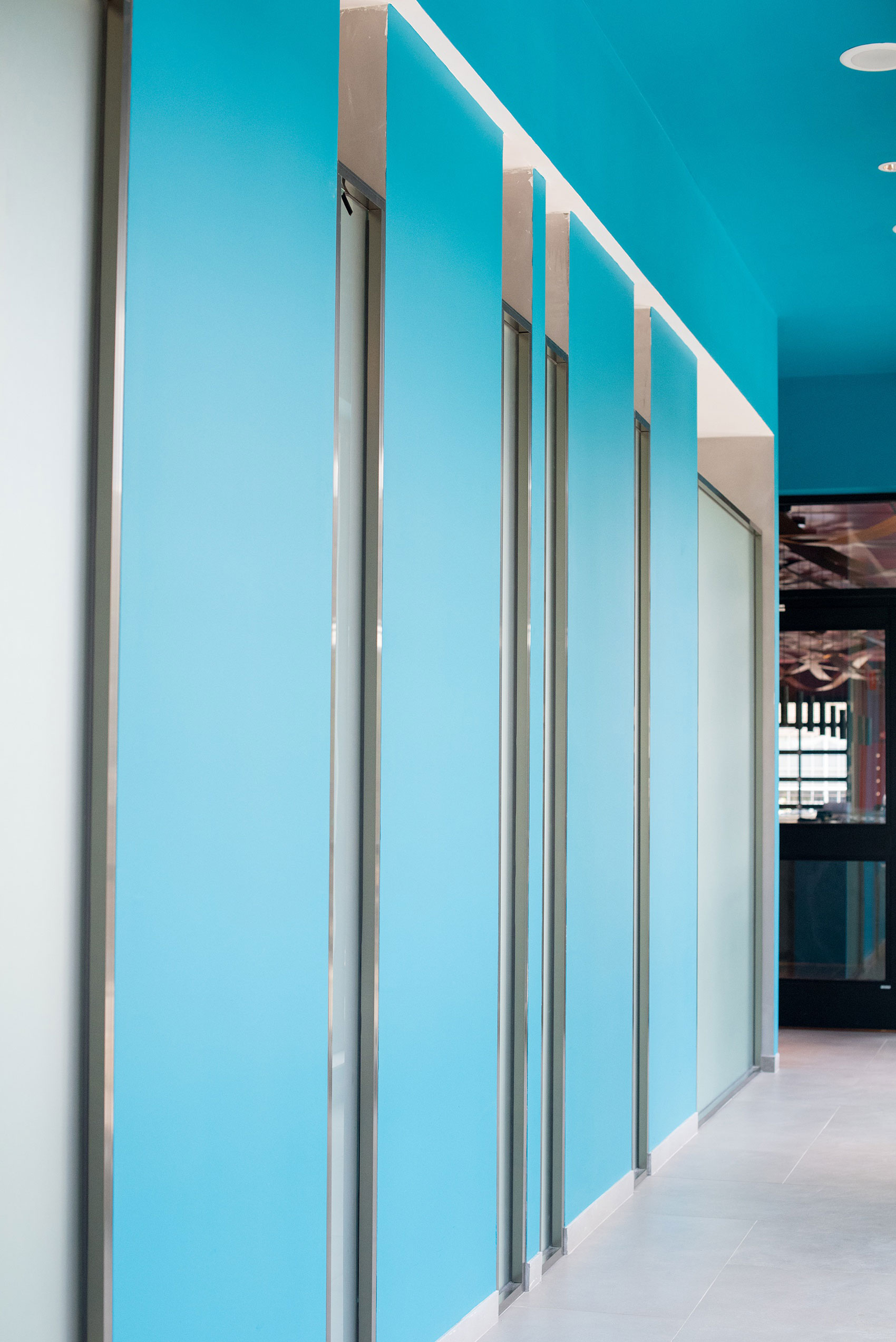 Photos of Vidrio restaurant in Raleigh, NC by Mikkel Paige Photography. Wedding venue in North Carolina with mediterranean and Spanish inspired art and interior design. Picture of a teal interior wall.