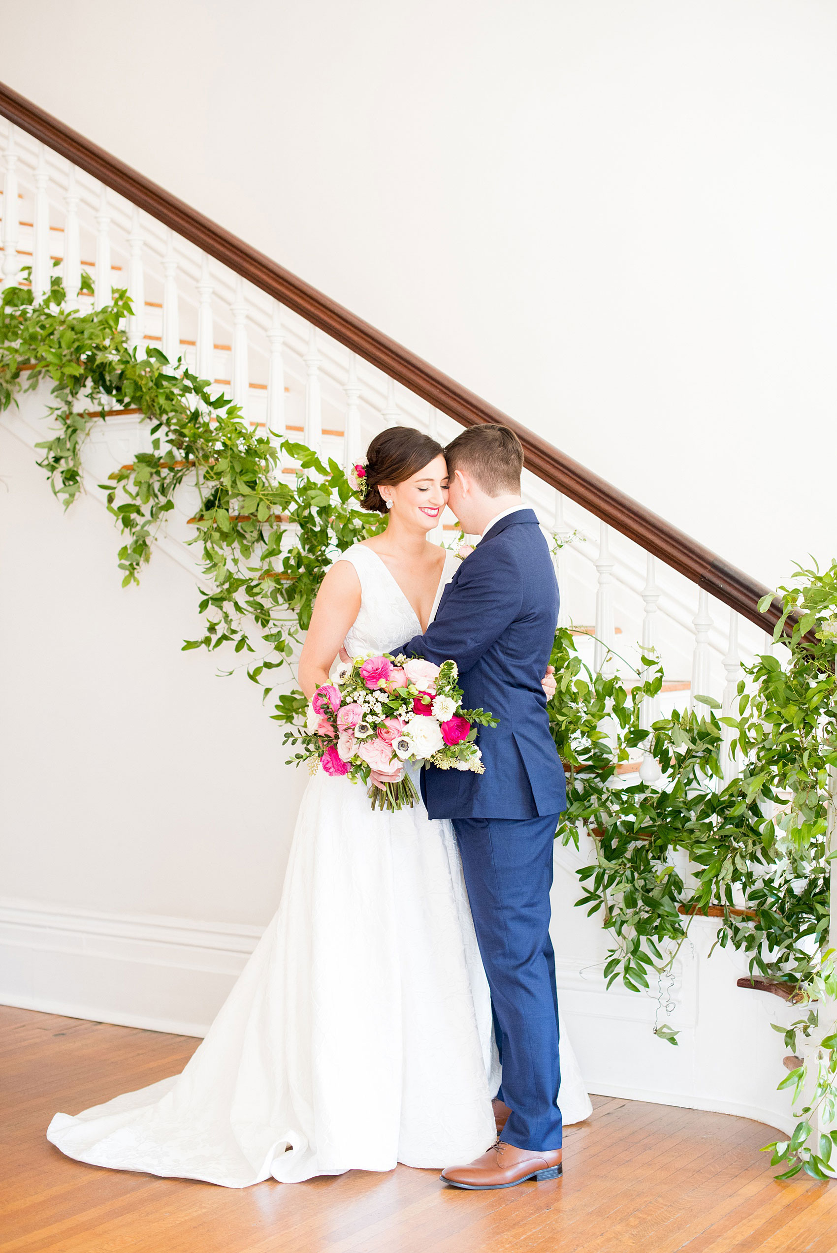 Mikkel Paige Photography pictures from a wedding at Merrimon-Wynne House in Raleigh, NC. Photo of the bride and groom near the staircase of the historic home.