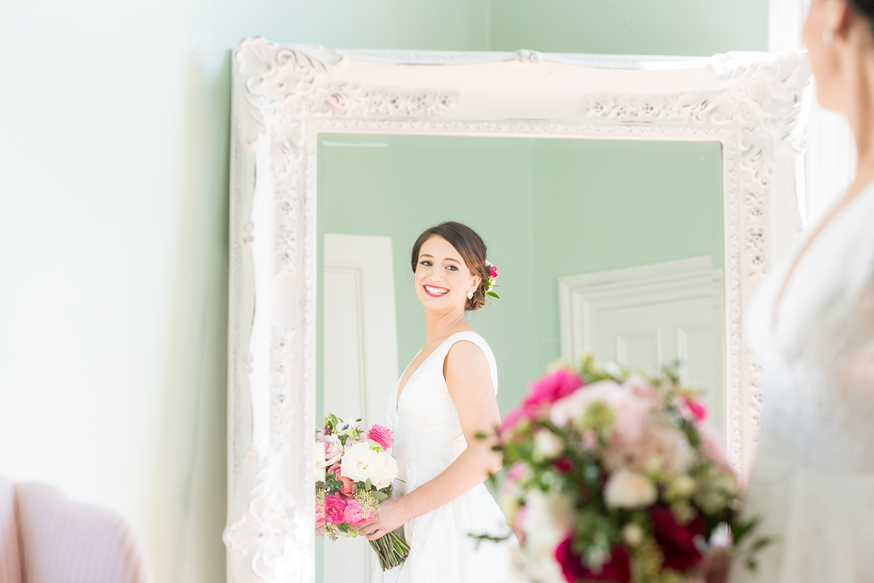 Mikkel Paige Photography pictures from a wedding at Merrimon-Wynne House in Raleigh, NC. Photo of the bride reflecting in a mirror in the bridal suite.