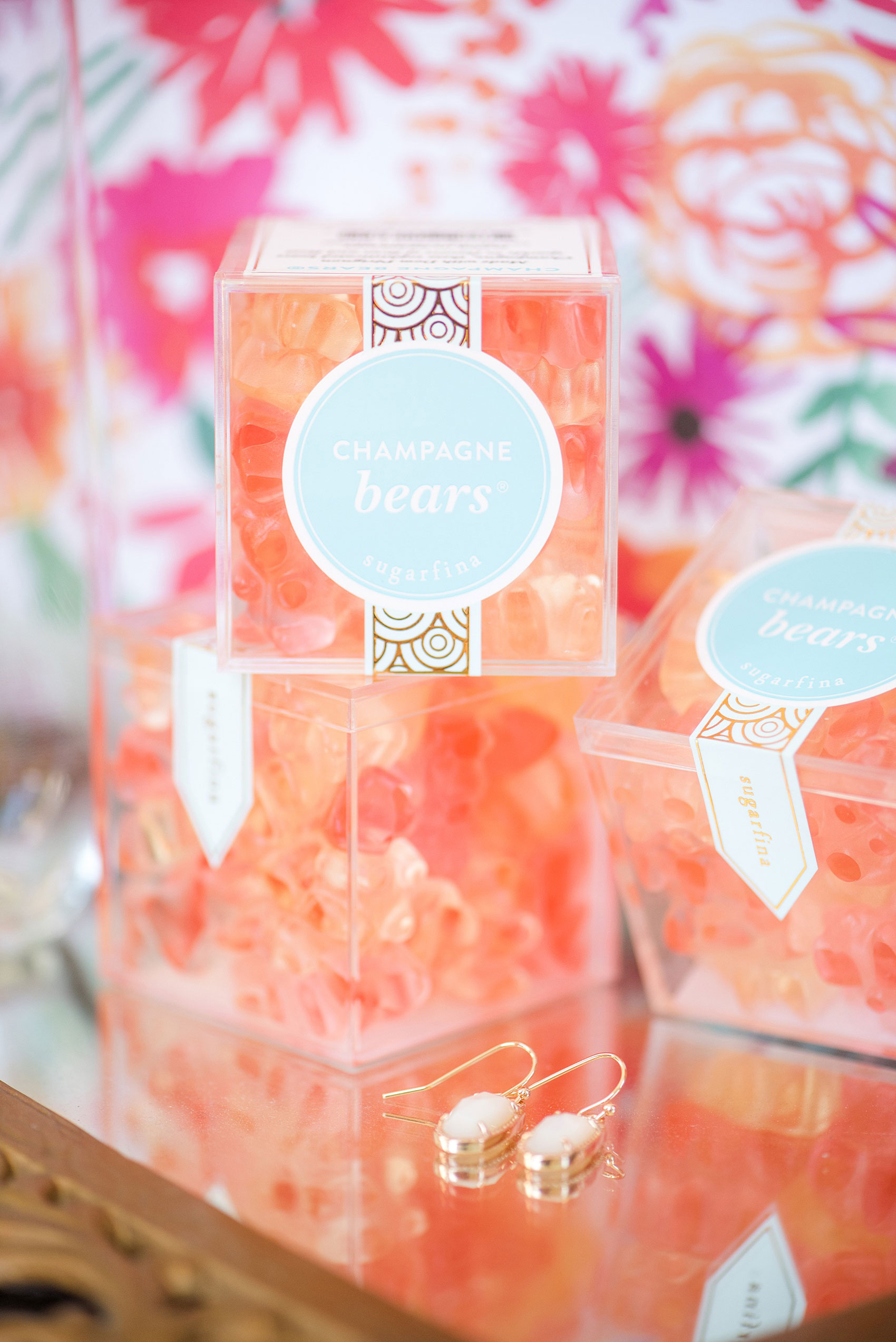 Mikkel Paige Photography pictures from a wedding at Merrimon-Wynne House in Raleigh, NC. Photo of the bridesmaids gift champagne gummy bears.