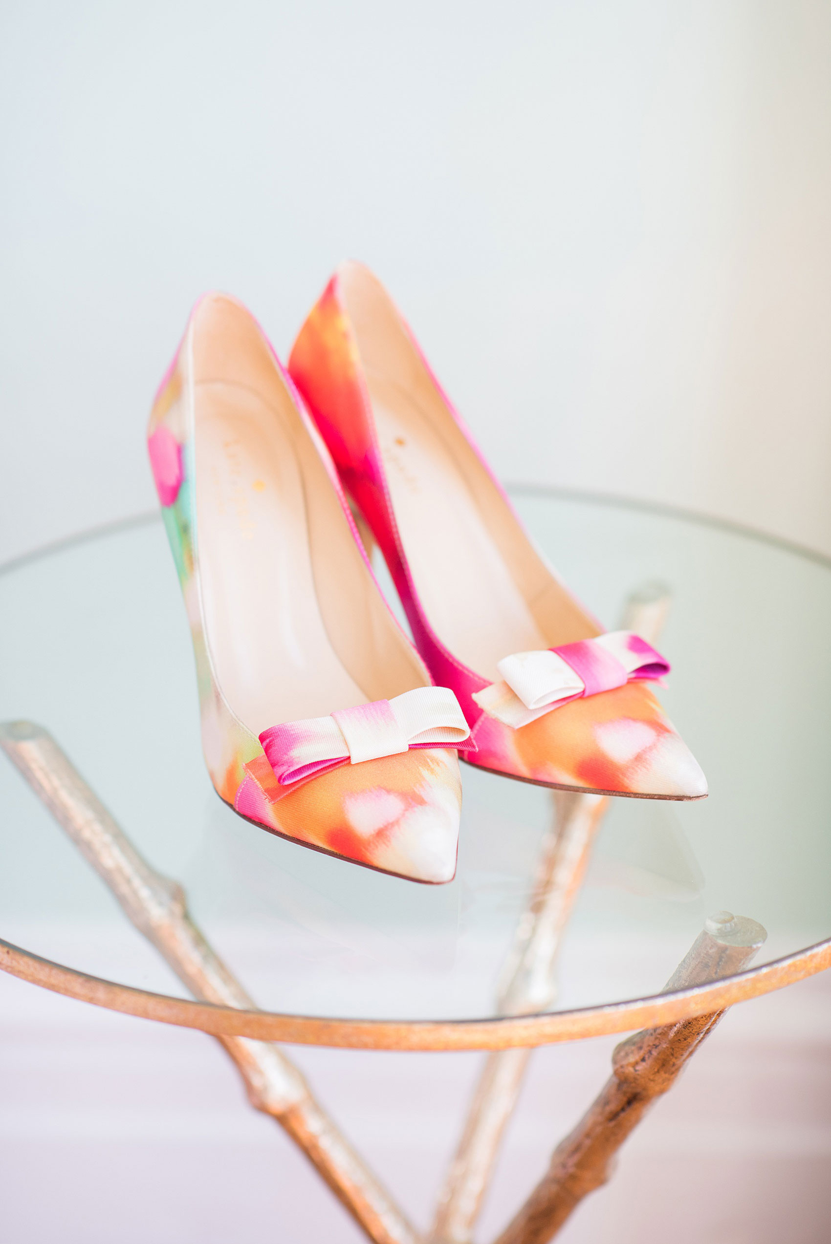 Mikkel Paige Photography pictures from a wedding at Merrimon-Wynne House in Raleigh, NC. Photo of the bride's colorful Ikat Kate Spade shoes.