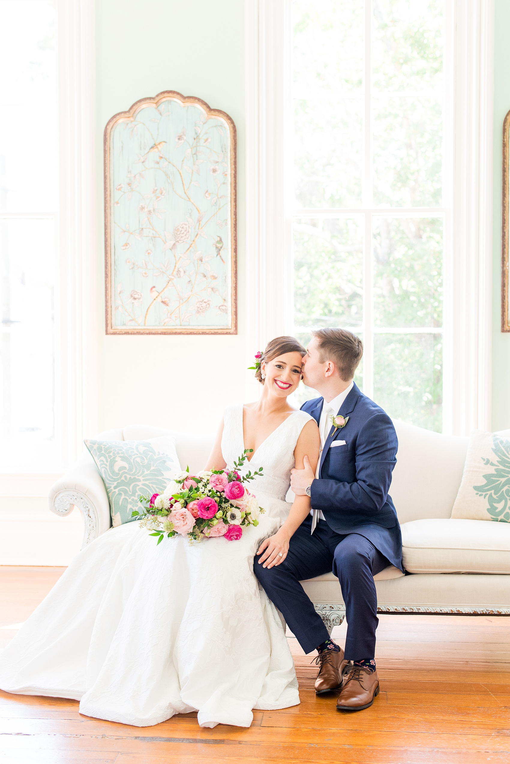 Mikkel Paige Photography pictures from a wedding at Merrimon-Wynne House in Raleigh, NC. Photo of the bride and groom in the bridal suite.