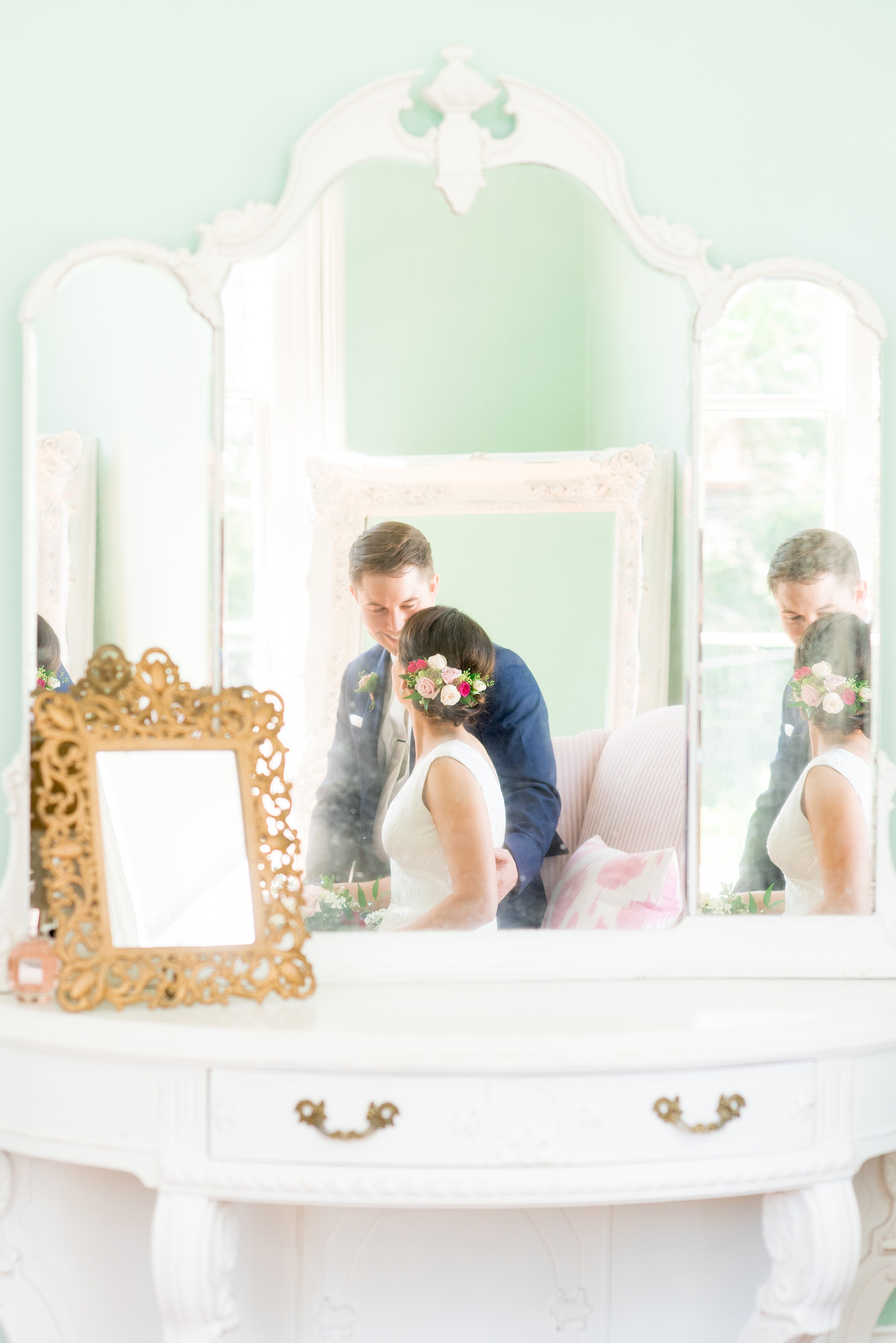 Mikkel Paige Photography pictures from a wedding at Merrimon-Wynne House in Raleigh, NC. Photo of the bride and groom in the mirror of the bridal suite.
