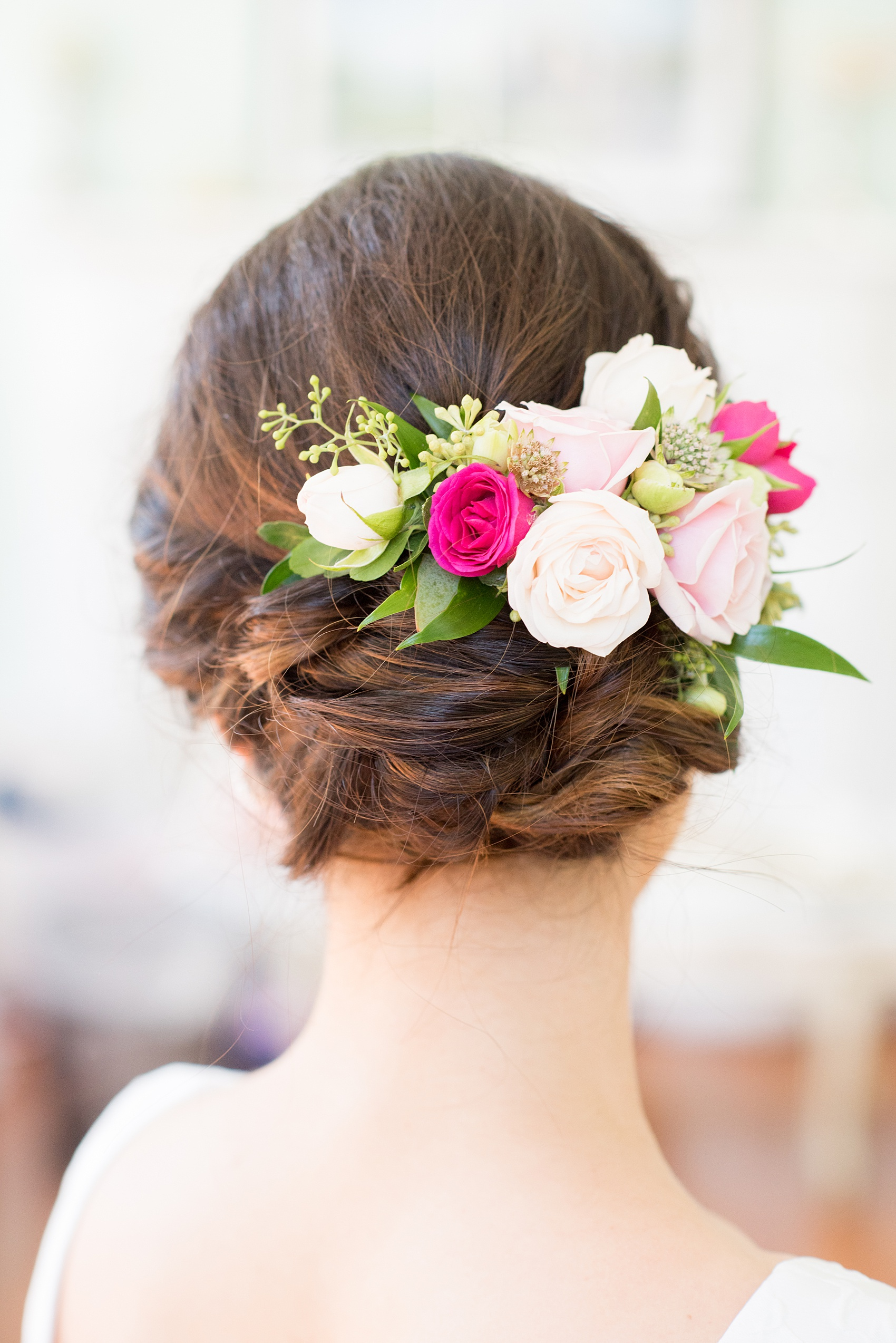 Mikkel Paige Photography pictures from a wedding at Merrimon-Wynne House in Raleigh, NC. Photo of the bride's up-do and flowers in her hair.