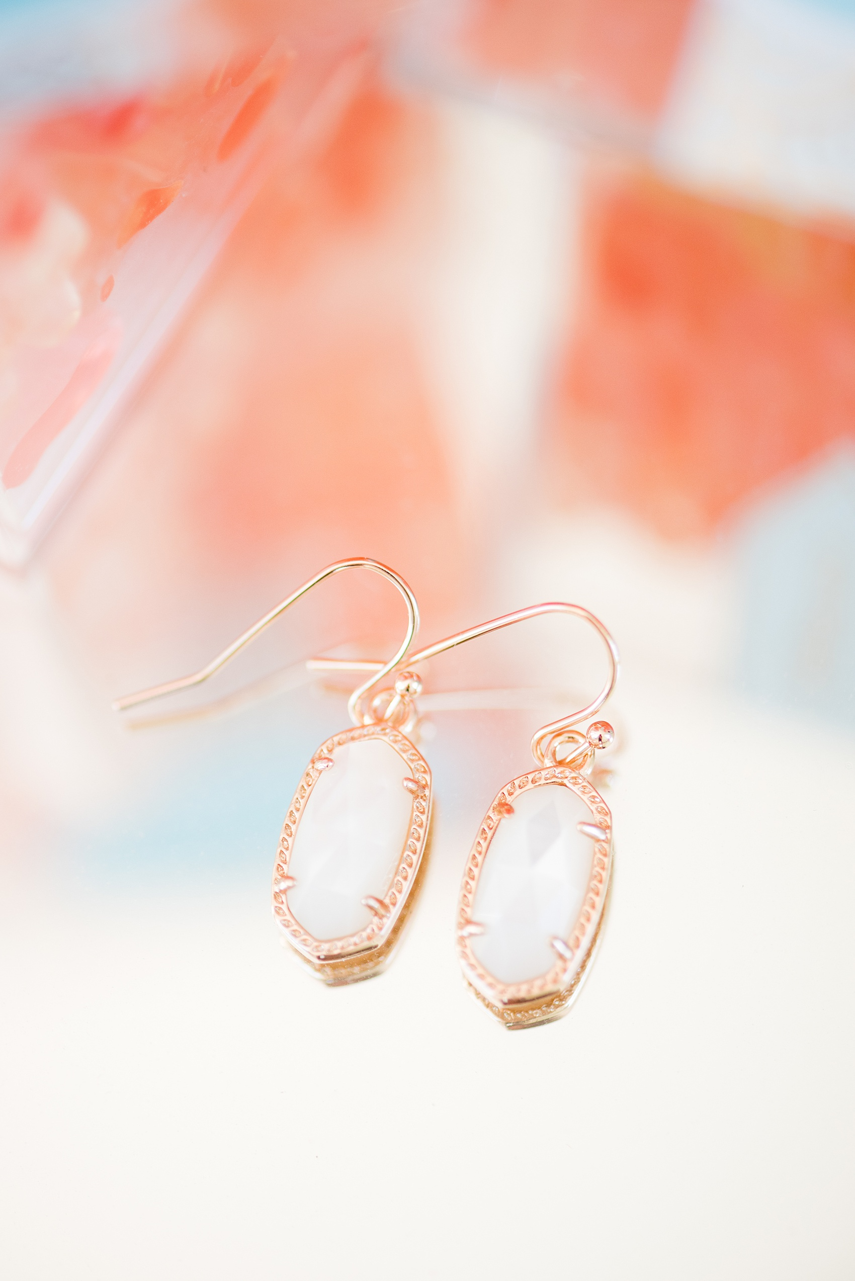 Mikkel Paige Photography pictures from a wedding at Merrimon-Wynne House in Raleigh, NC. Detail photo of the Kendra Scott earrings the bride gifted her bridesmaids.