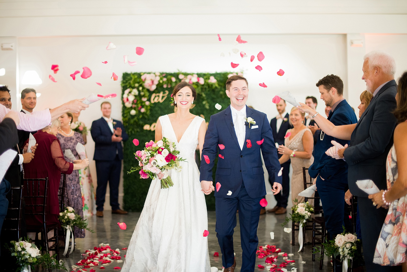 Mikkel Paige Photography pictures from a wedding at Merrimon-Wynne House in Raleigh, NC. Photo of the bride and groom after their ceremony during their petal toss.