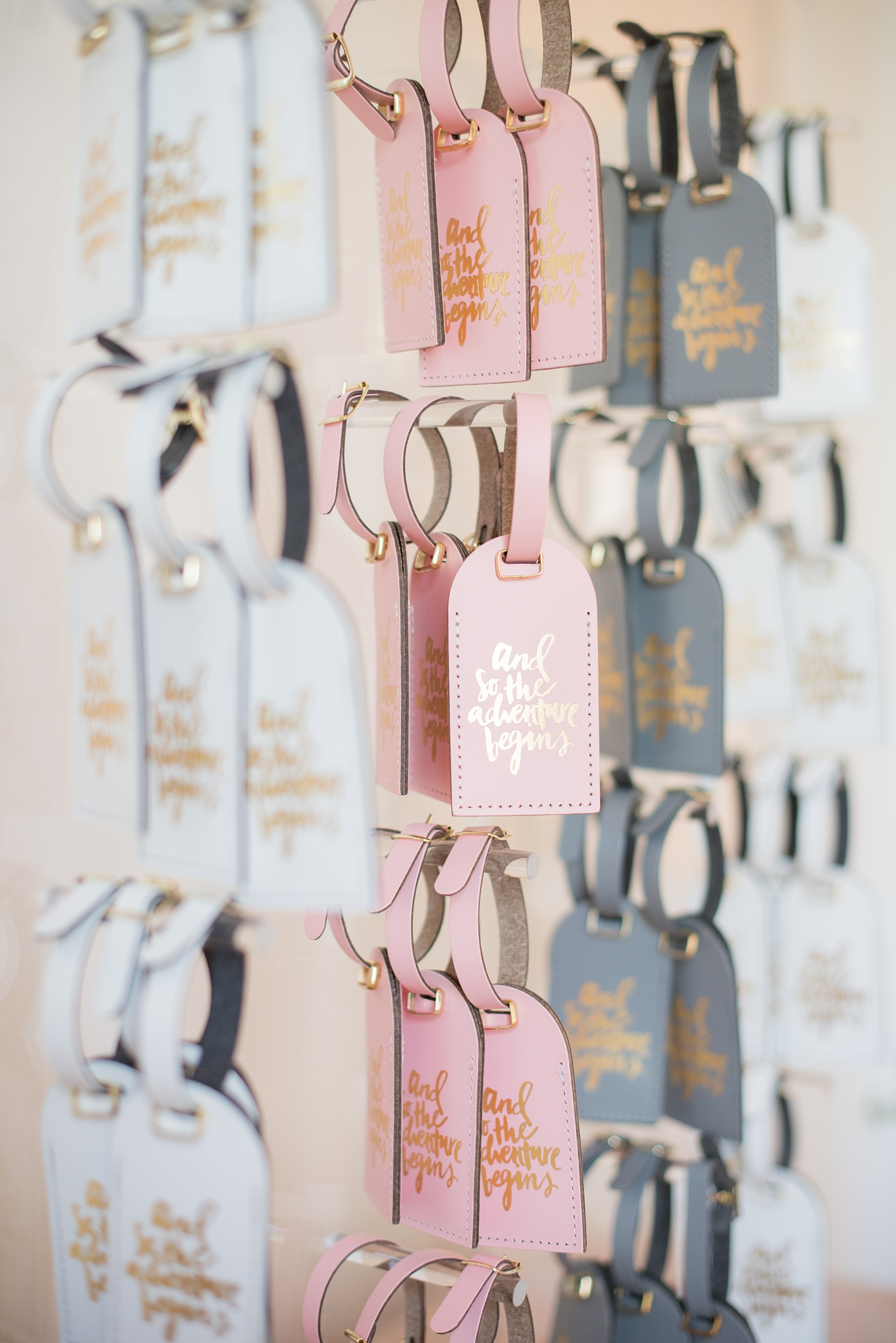 Mikkel Paige Photography pictures from a wedding at Merrimon-Wynne House in Raleigh, NC. Photo of the creative, unique escort cards. Guests found their tables on luggage tags on an acrylic board.