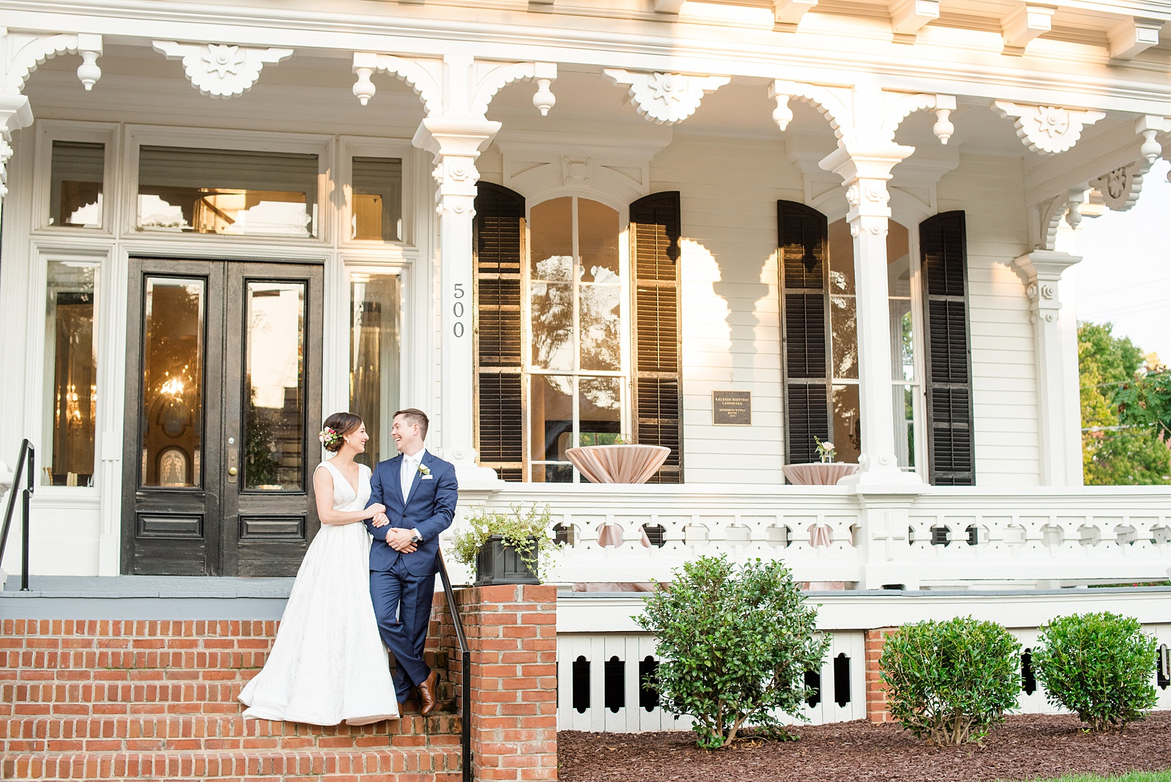Mikkel Paige Photography pictures from a wedding at Merrimon-Wynne House in Raleigh, NC. Photo of the bride and groom in front of the historic home.