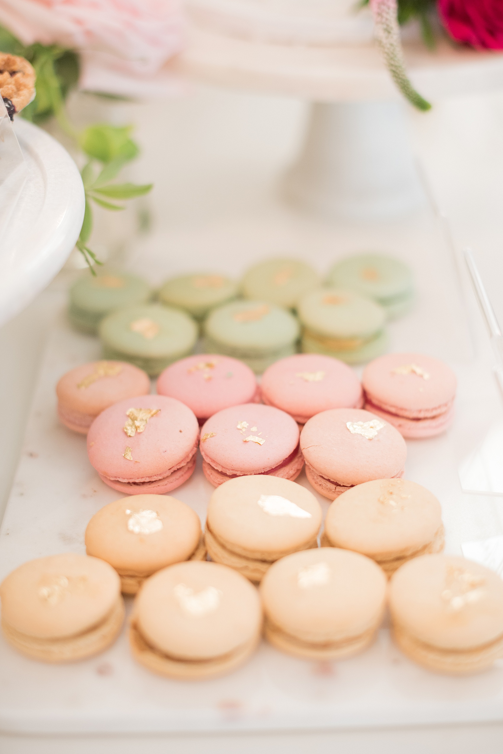 Mikkel Paige Photography pictures from a wedding at Merrimon-Wynne House in Raleigh, NC. Photo of macarons with gold leaf on the dessert table.