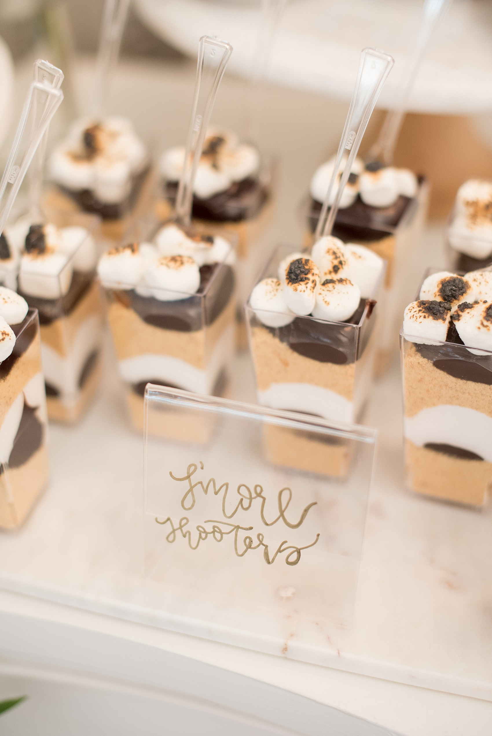 Mikkel Paige Photography pictures from a wedding at Merrimon-Wynne House in Raleigh, NC. Photo of s'mores cups on the dessert table.