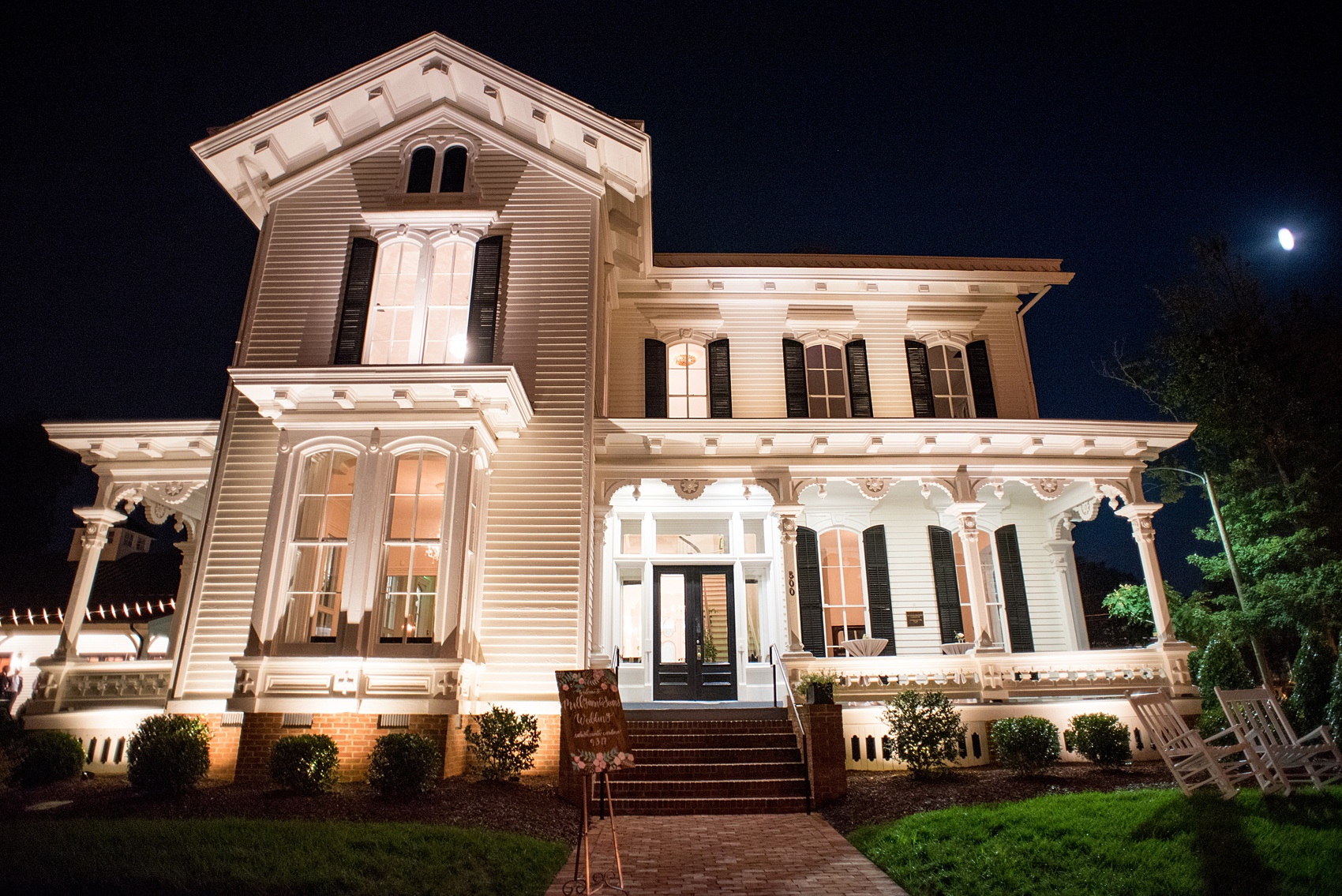 Mikkel Paige Photography pictures from a wedding at Merrimon-Wynne House in Raleigh, NC. Photo of historic home at night.