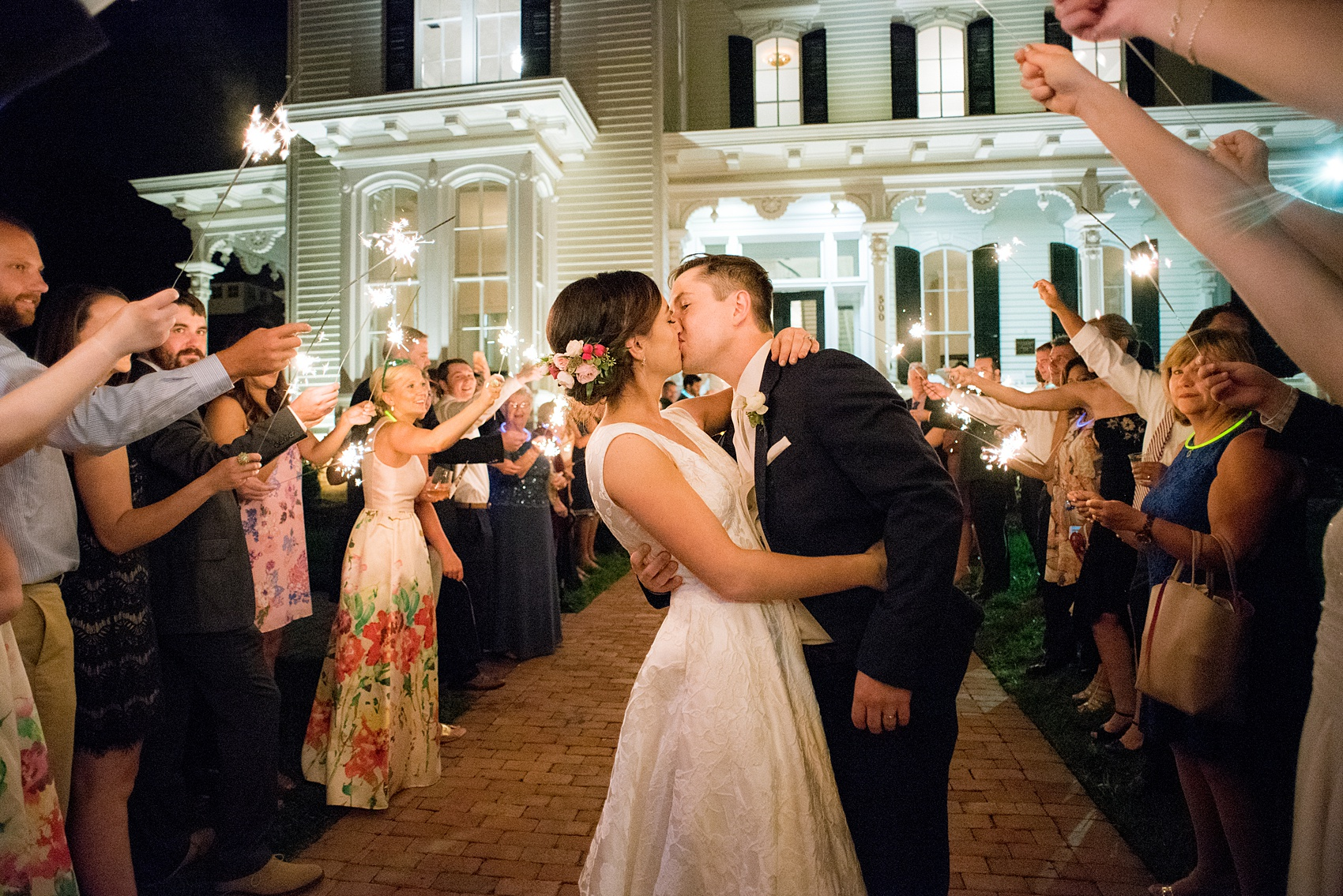 Mikkel Paige Photography pictures from a wedding at Merrimon-Wynne House in Raleigh, NC. Photo of the bride and groom's sparkler exit.