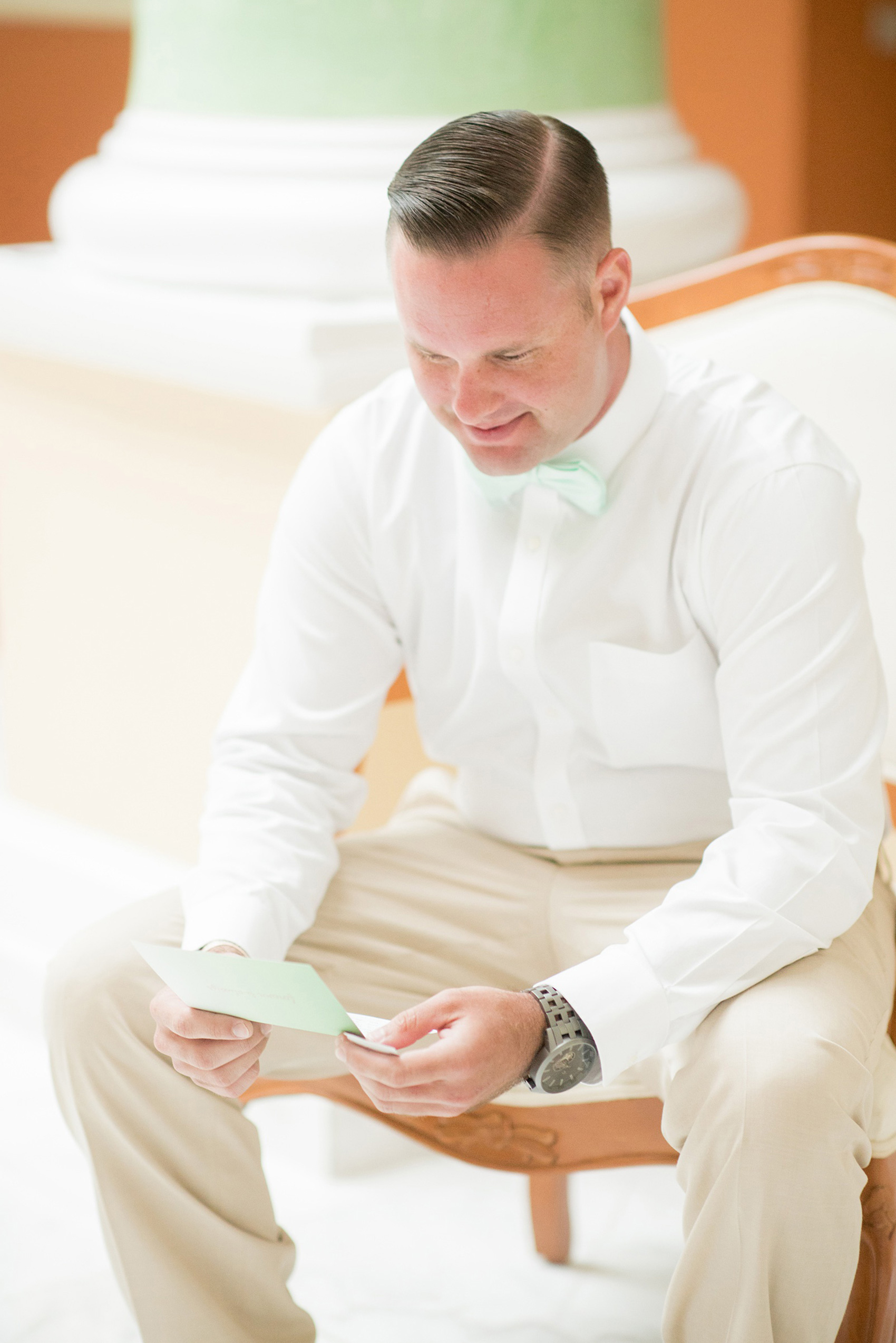 Mikkel Paige Photography photos from a wedding at Grand Paraiso, Mexico, Playa del Carmen Iberostar resort. Picture of the groom reading a letter form his bride.