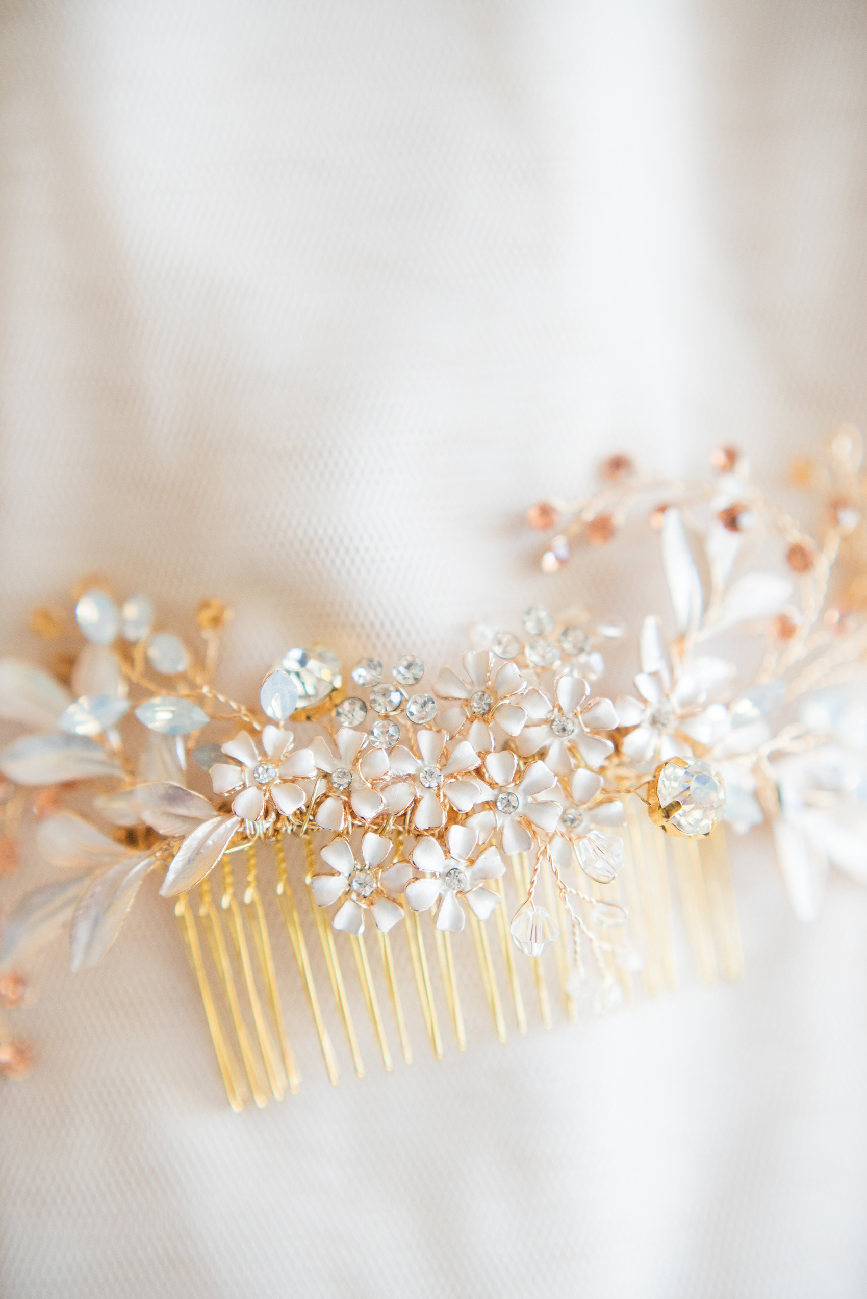 Mikkel Paige Photography photos from a wedding at Grand Paraiso, Mexico, Playa del Carmen Iberostar resort. Detail picture of the bride's rhinestone hair comb.