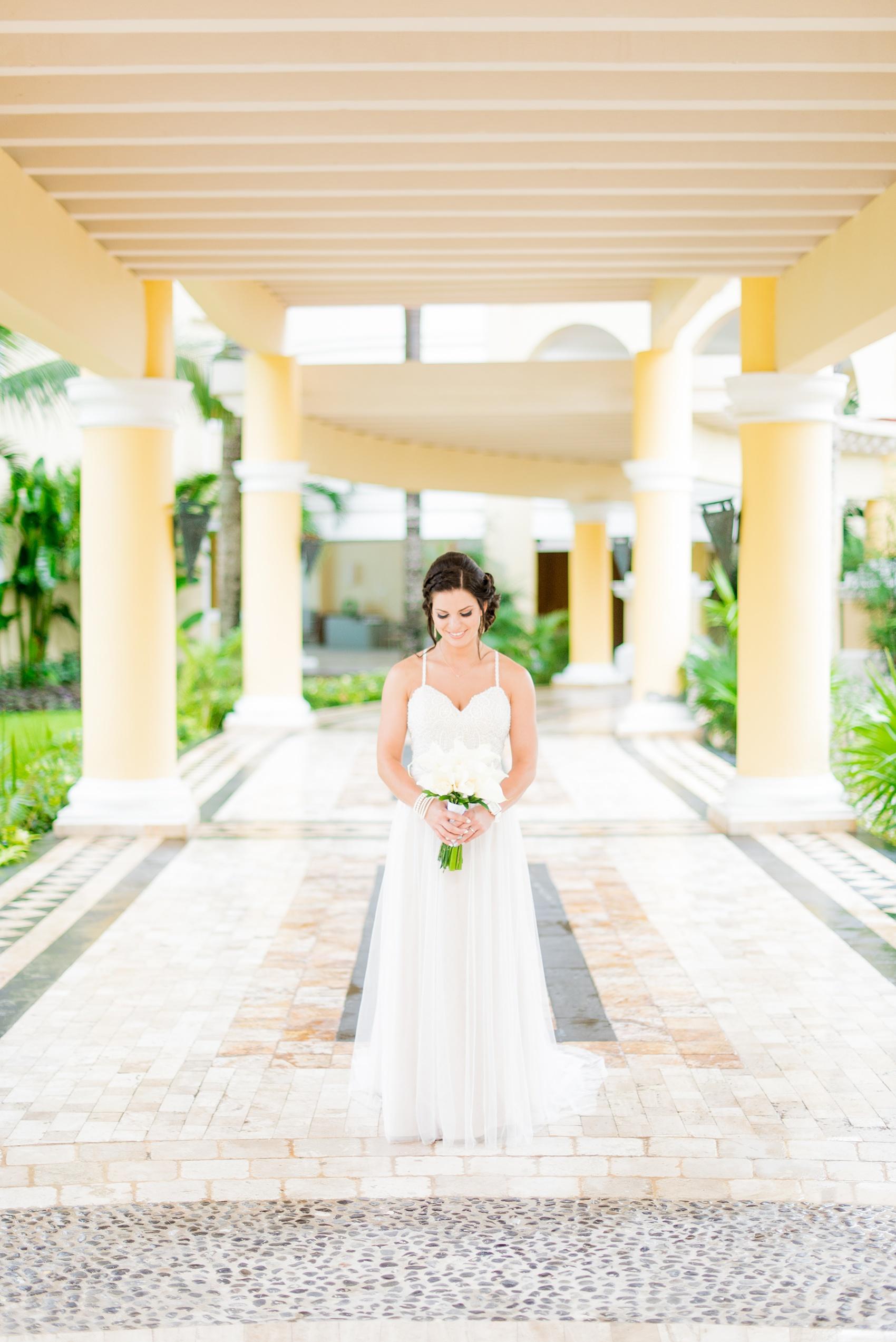 Mikkel Paige Photography photos from a wedding at Grand Paraiso, Mexico, Playa del Carmen Iberostar resort. Picture of the bride in her beach dress with tulle skirt.
