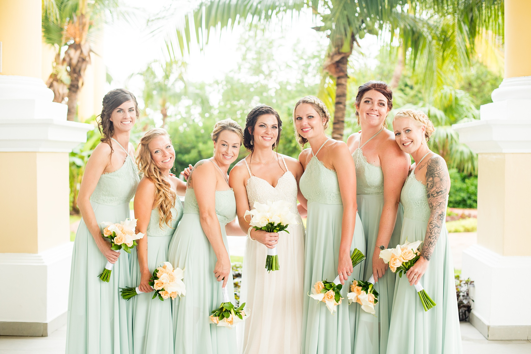 Mikkel Paige Photography photos from a wedding at Grand Paraiso, Mexico, Playa del Carmen Iberostar resort. Picture of the bride and her bridesmaids. The bridesmaids wore mint green gowns.