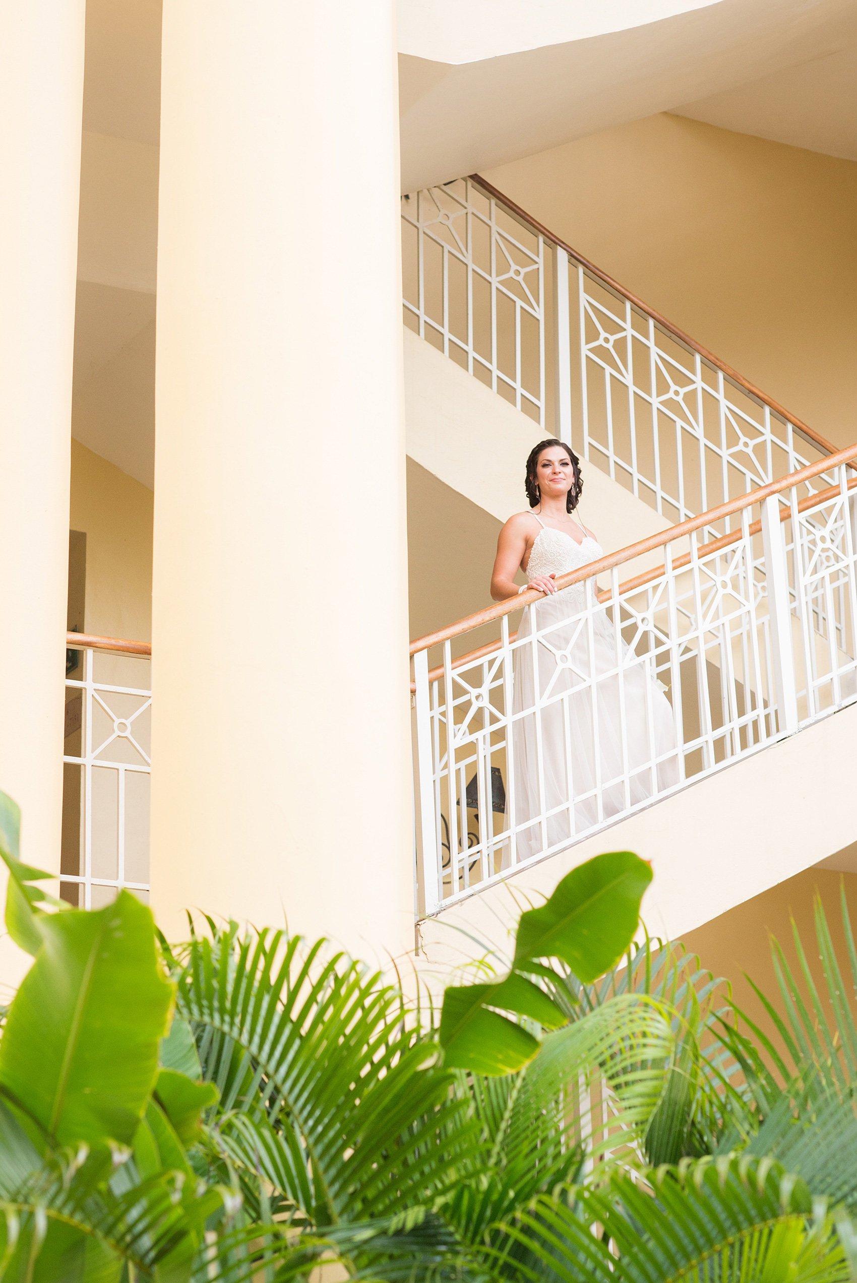 Mikkel Paige Photography photos from a wedding at Grand Paraiso, Mexico, Playa del Carmen Iberostar resort. Picture of the bride in on a staircase at the resort.