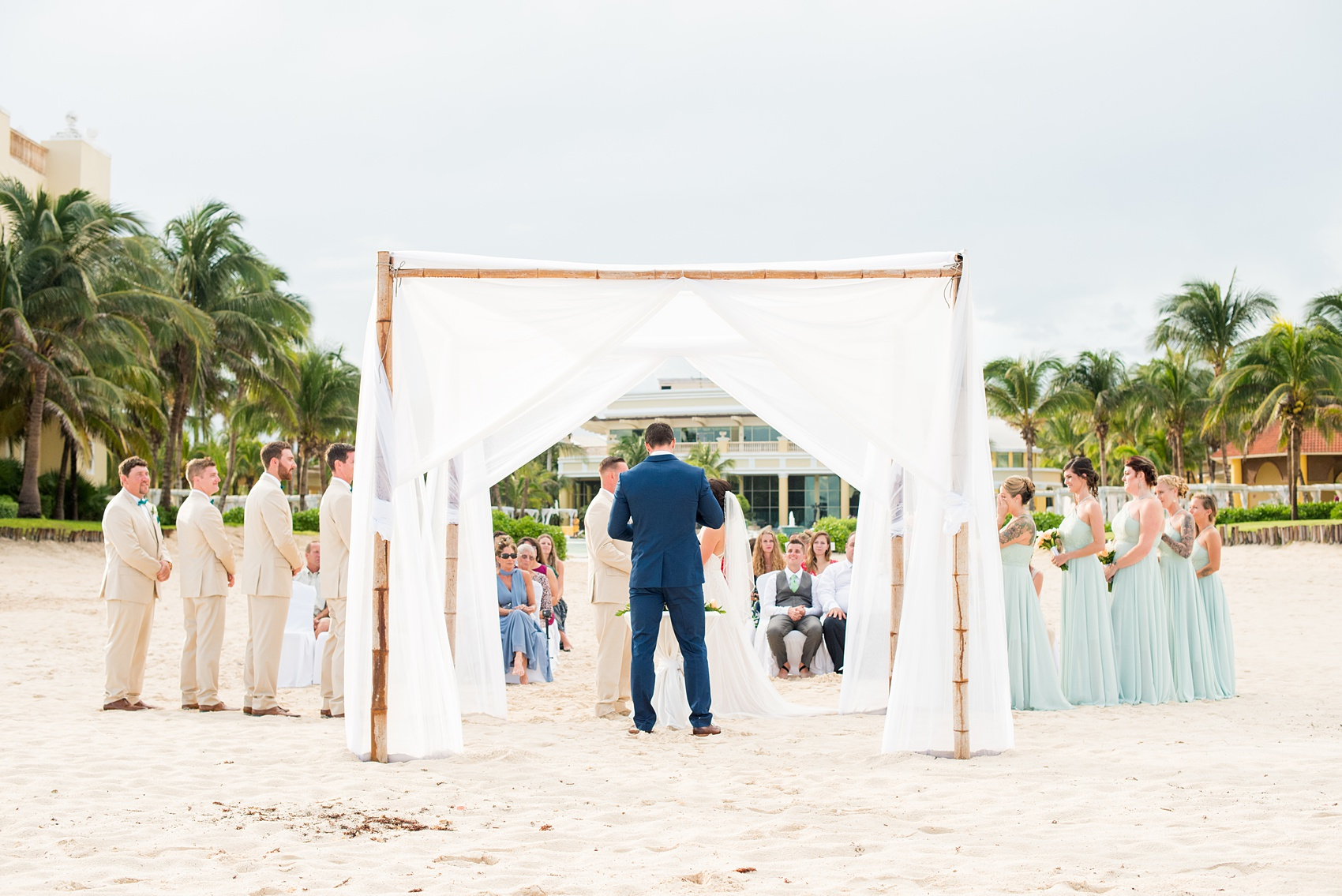 Mikkel Paige Photography photos from a wedding at Grand Paraiso, Mexico, Playa del Carmen Iberostar resort. Picture of their beach ceremony.