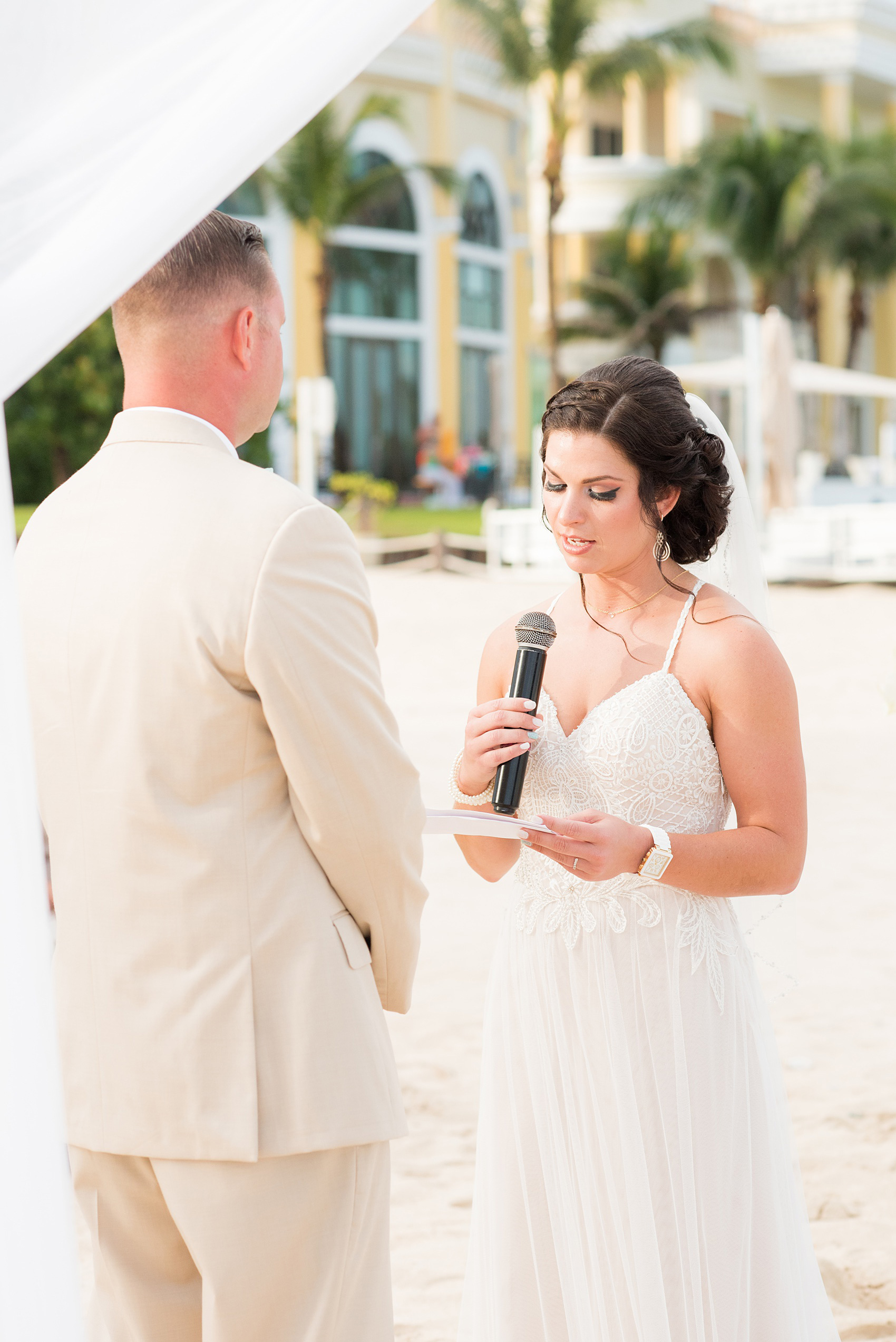 Mikkel Paige Photography photos from a wedding at Grand Paraiso, Mexico, Playa del Carmen Iberostar resort. Picture of the bride reciting her vows at their beach ceremony.