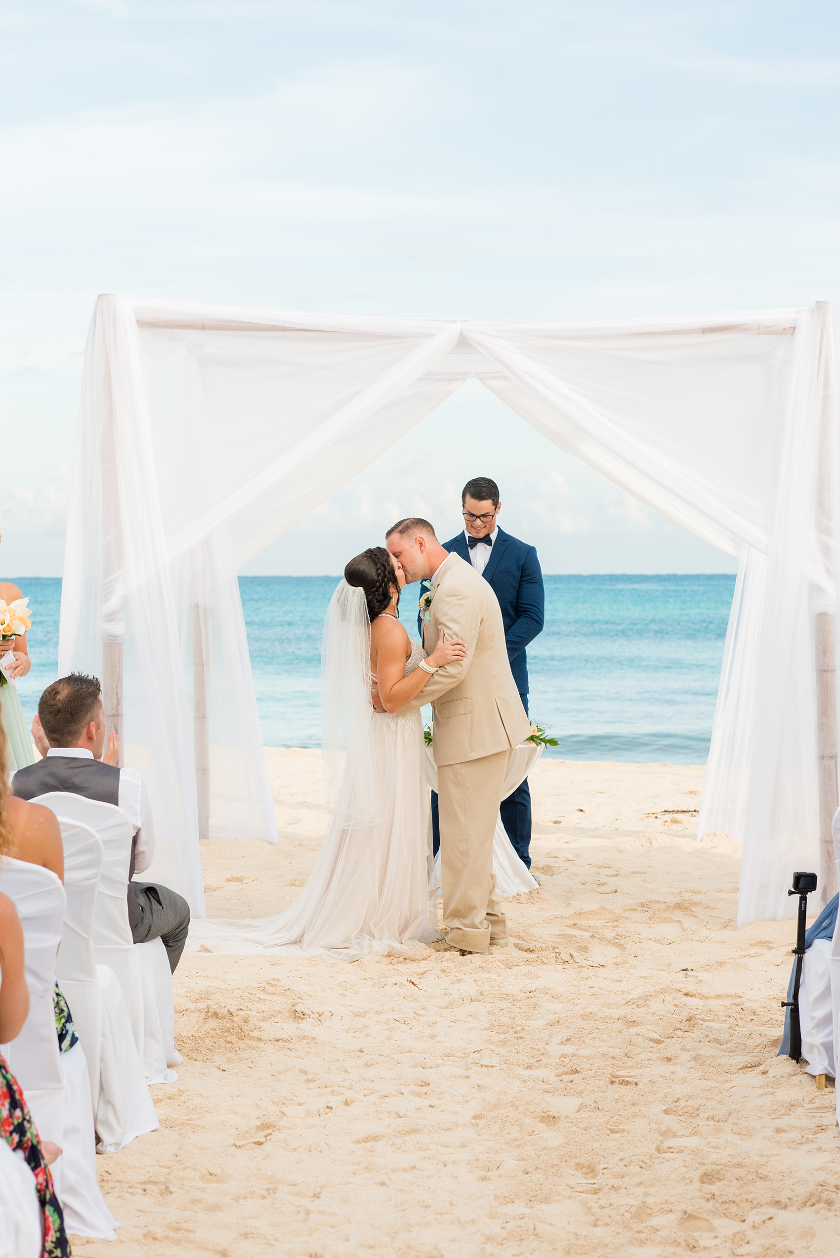 Mikkel Paige Photography photos from a wedding at Grand Paraiso, Mexico, Playa del Carmen Iberostar resort. Picture of the bride and groom's first kiss at their beach ceremony.
