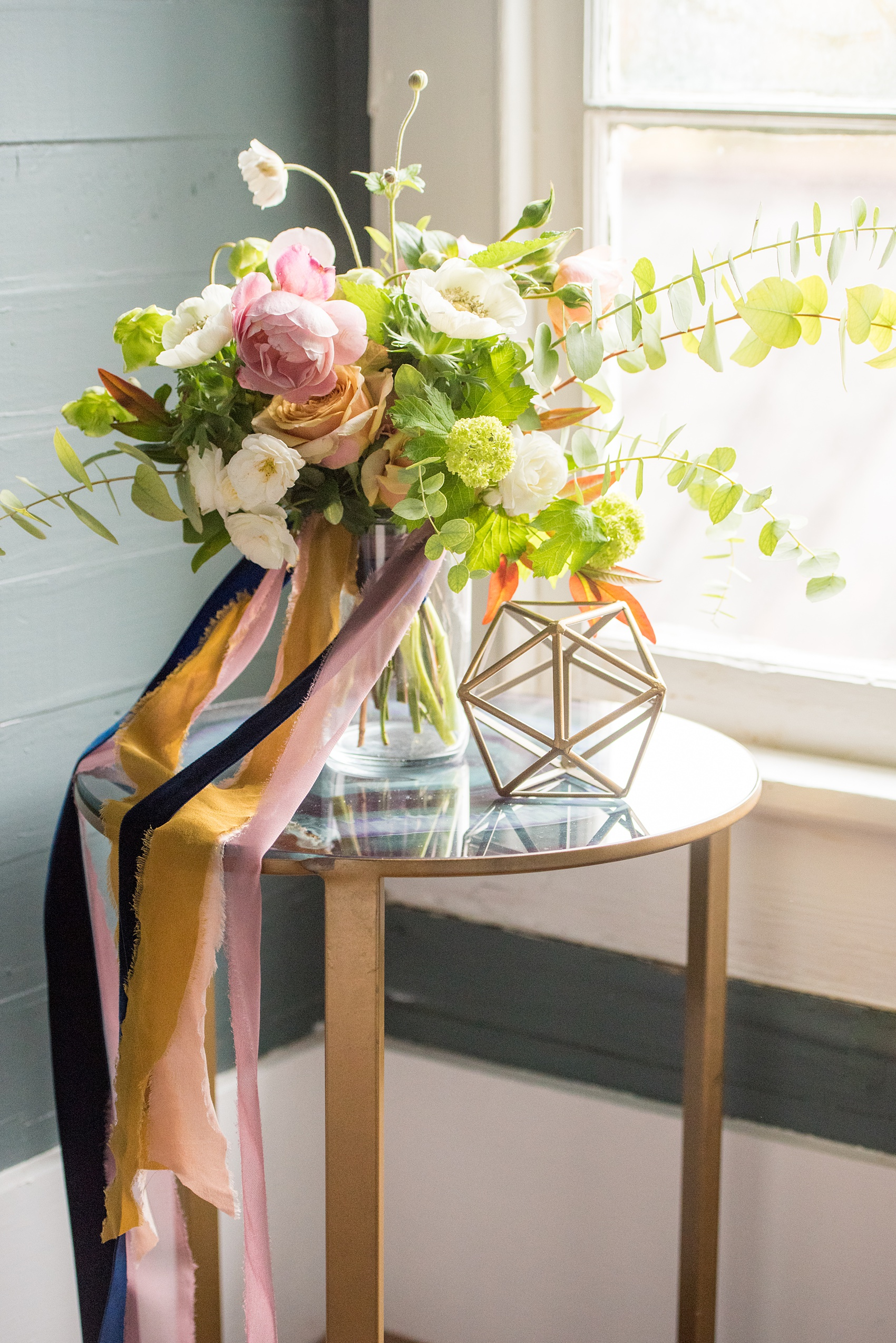 Mikkel Paige Photography photos from a wedding at Leslie-Alford Mims House in North Carolina. Picture of the bride's colorful fall bouquet, tied with silk and velvet ribbons by Caroline Ruth Designs and Mad Dash Weddings.