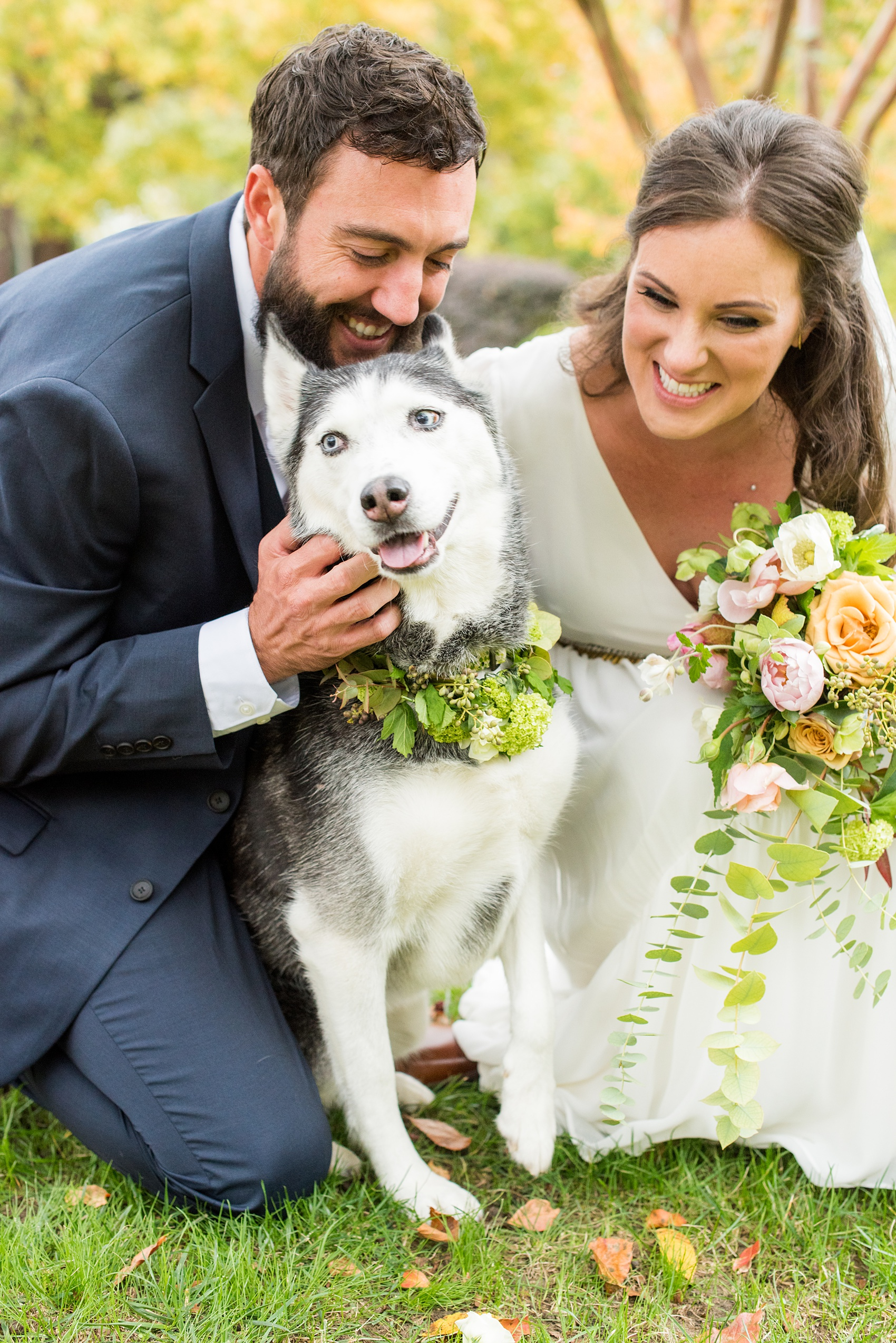 Mikkel Paige Photography photos from a wedding at Leslie-Alford Mims House in North Carolina. Picture of the bride and groom with their Husky dog in a flower collar.