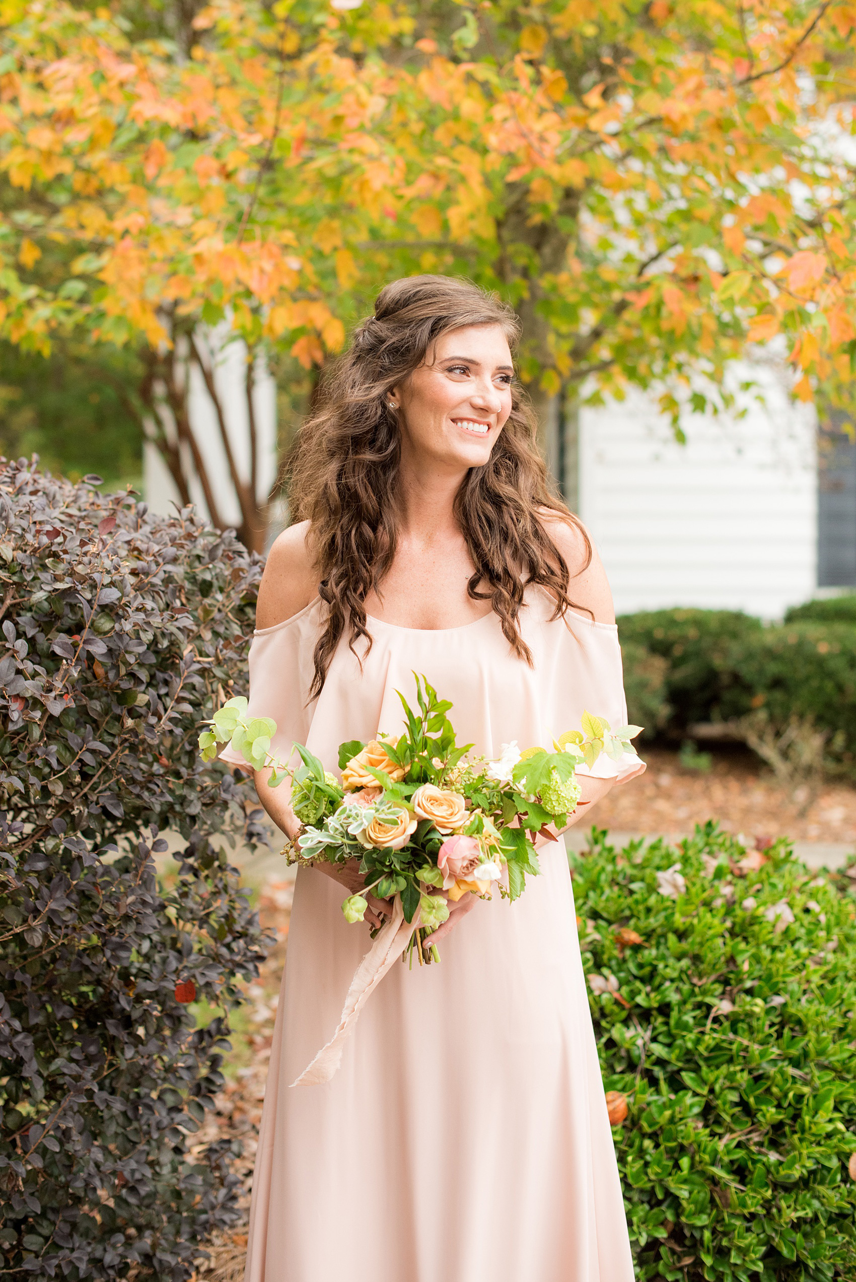 Mikkel Paige Photography photos from a wedding at Leslie-Alford Mims House in North Carolina. Picture of a bridesmaid in a light pink chiffon gown with peek-a-boo shoulders for a fall Mad Dash Weddings event.