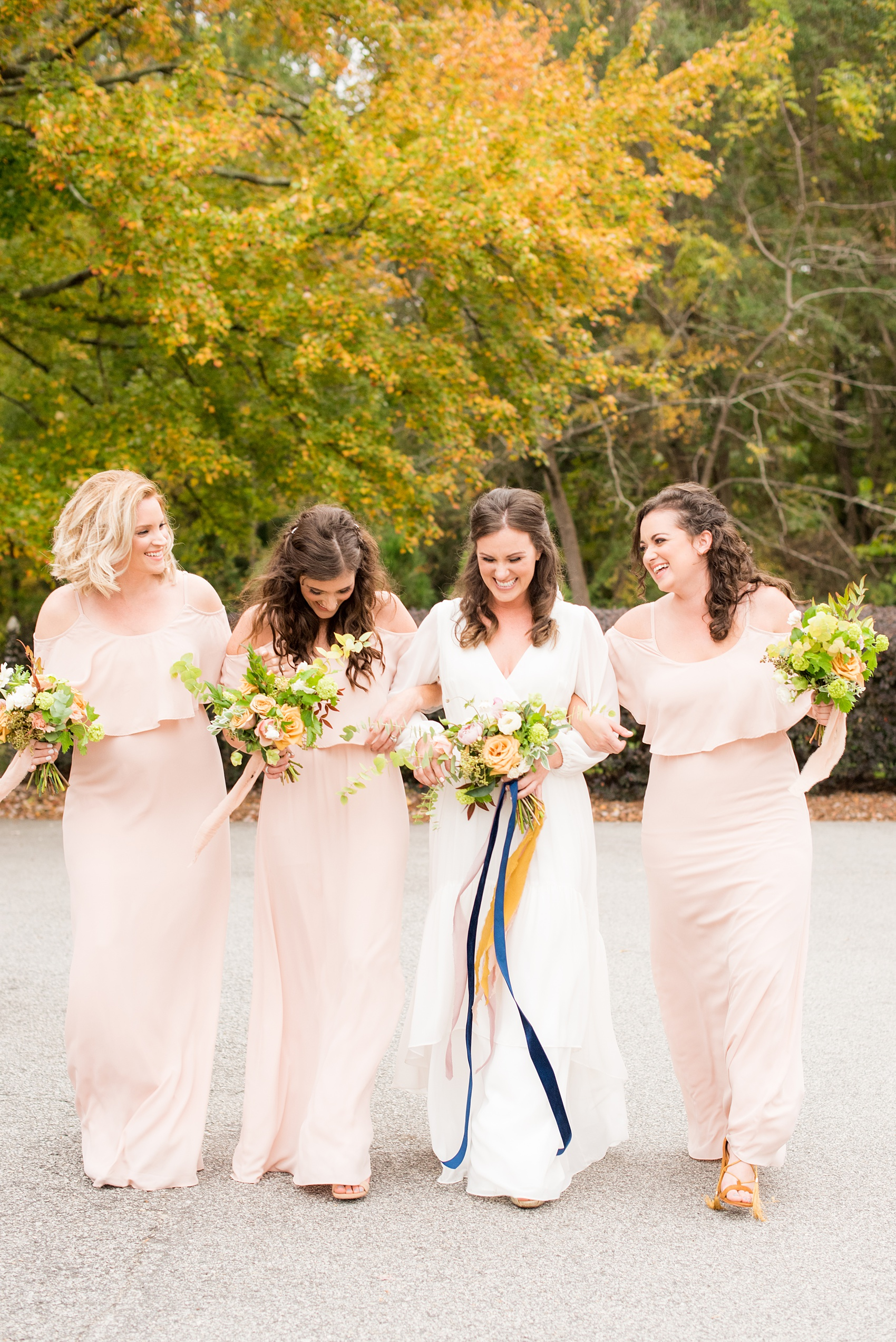 Mikkel Paige Photography photos from a wedding at Leslie-Alford Mims House in North Carolina. Picture of the bridal party in light pink, off-the-shoulder, chiffon dresses for a fall Mad Dash Weddings event.