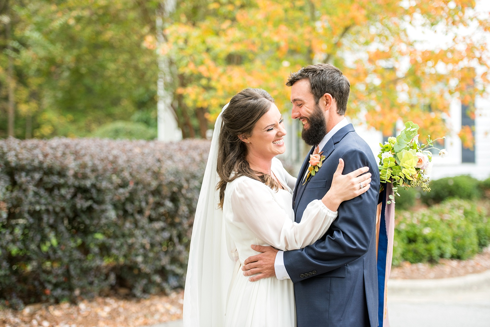 Mikkel Paige Photography photos from a wedding at Leslie-Alford Mims House in North Carolina. Picture of the Boho bride and groom in a navy suit for their fall day.