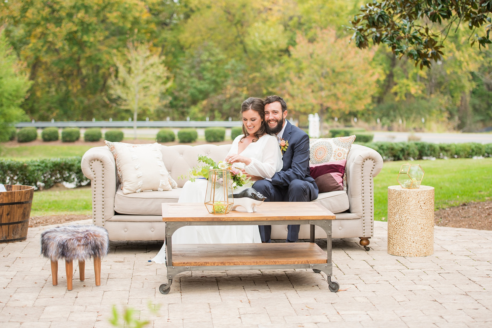 Mikkel Paige Photography photos from a wedding at Leslie-Alford Mims House in North Carolina. Photo of the bride and groom on their outdoor reception lounge furniture from Greenhouse Picker Sisters for a Mad Dash Weddings event.