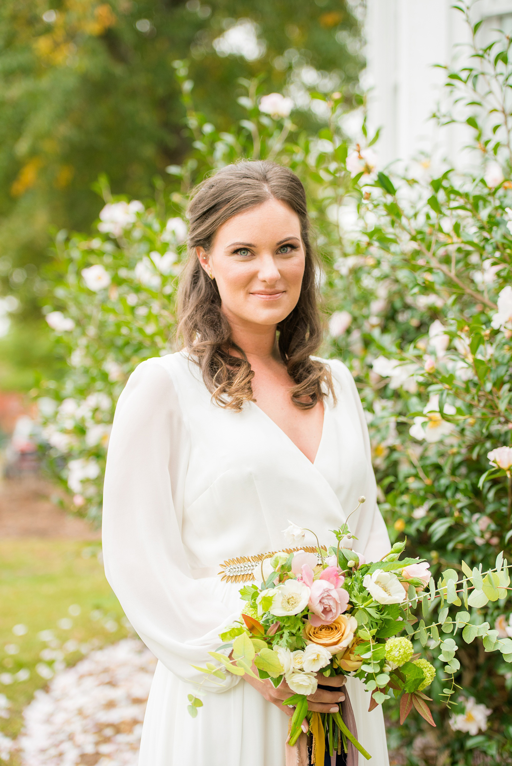 Mikkel Paige Photography photos from a wedding at Leslie-Alford Mims House in North Carolina. Portrait photo of the bride in her long-sleeve, white chiffon gown from BHLDN and fall flowers with long, autumn ribbons by Caroline Ruth Designs for a Mad Dash Wedding.