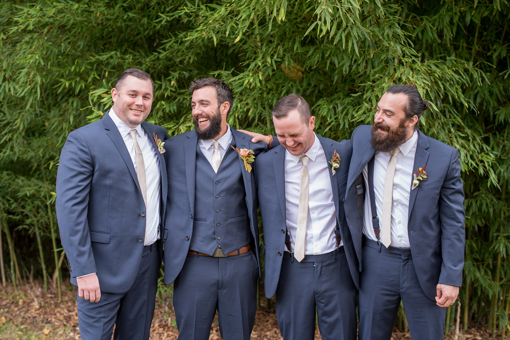 Mikkel Paige Photography photos from a wedding at Leslie-Alford Mims House in North Carolina. Candid picture of the groomsmen in navy blue linen suits for a fall Mad Dash Weddings event.