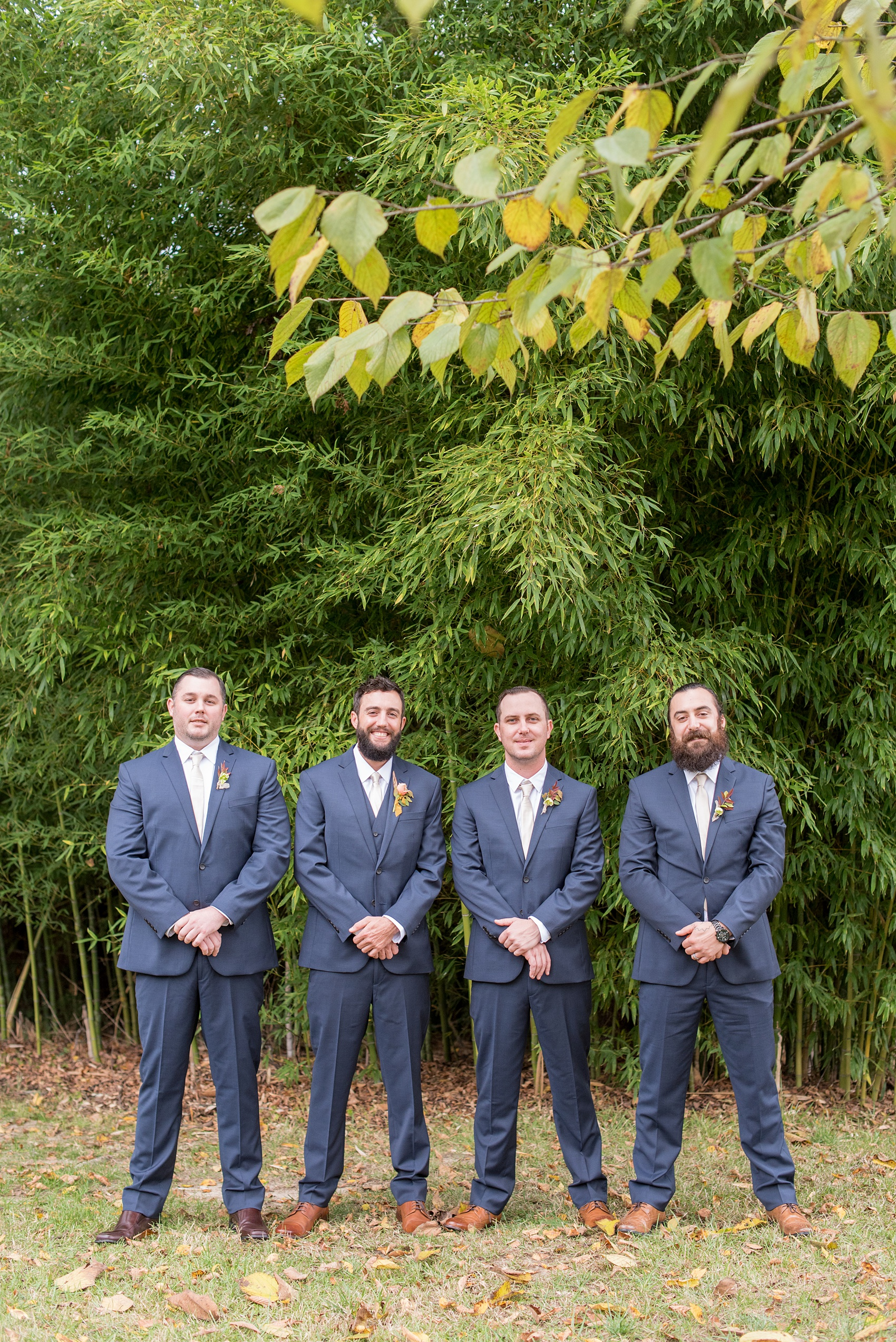 Mikkel Paige Photography photos from a wedding at Leslie-Alford Mims House in North Carolina. Picture of the groomsmen in navy blue linen suits for a fall Mad Dash Weddings event.