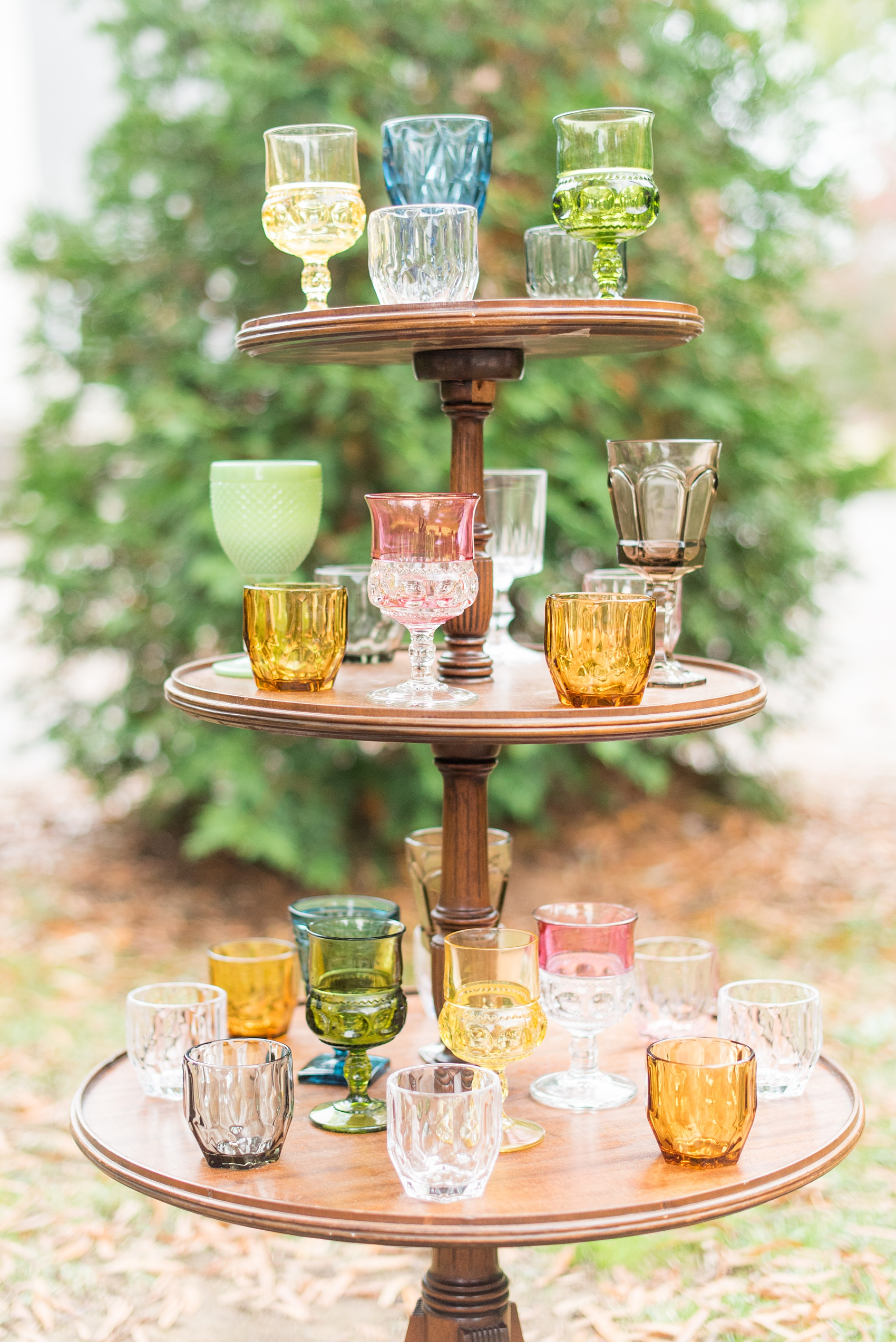 Mikkel Paige Photography photos from a wedding at Leslie-Alford Mims House in North Carolina. Picture of the mixed colored vintage glasses display.
