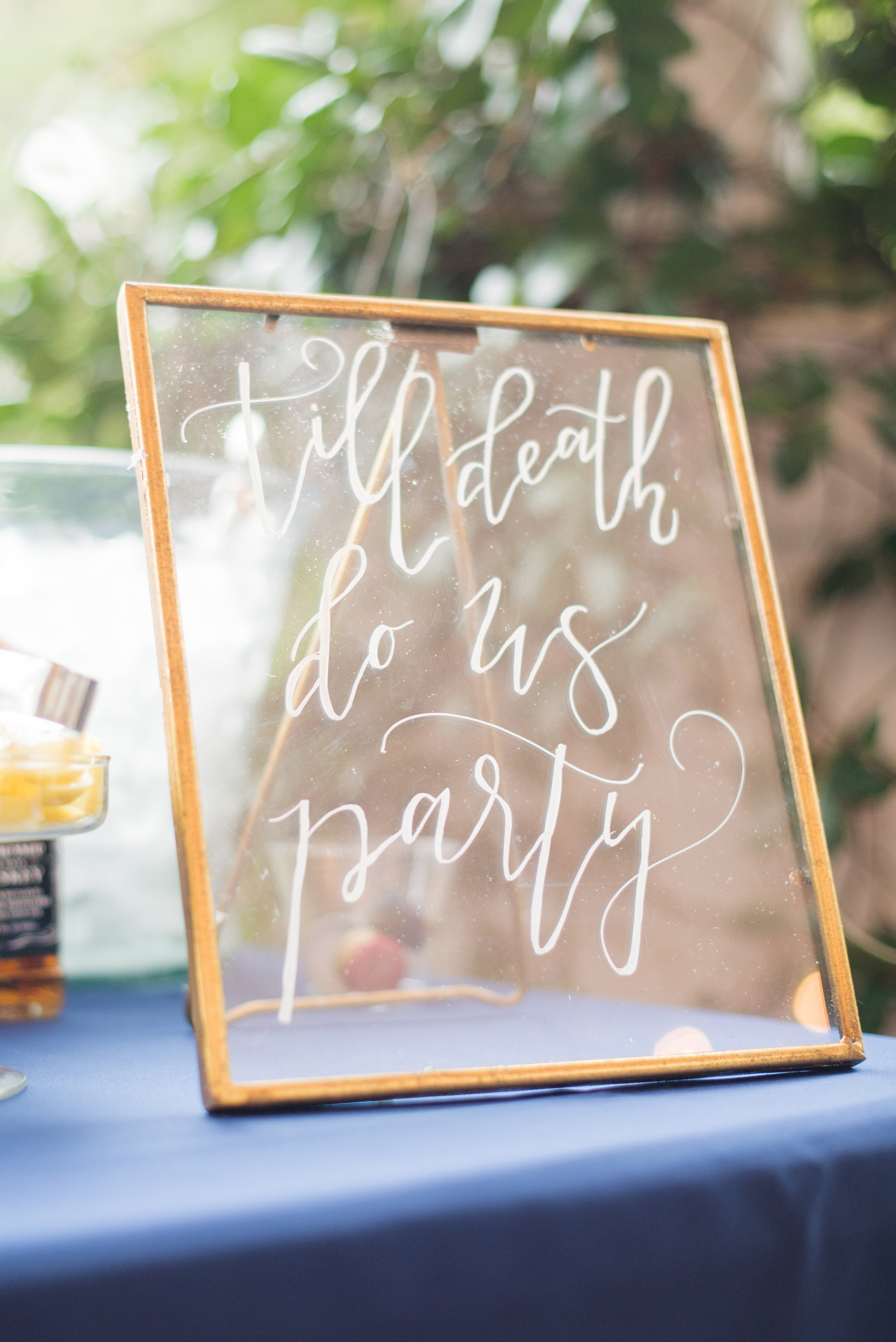 """Mikkel Paige Photography photos from a wedding at Leslie-Alford Mims House in North Carolina. Picture of the """"Til Death do Us Party"""" glass calligraphy bar sign."""