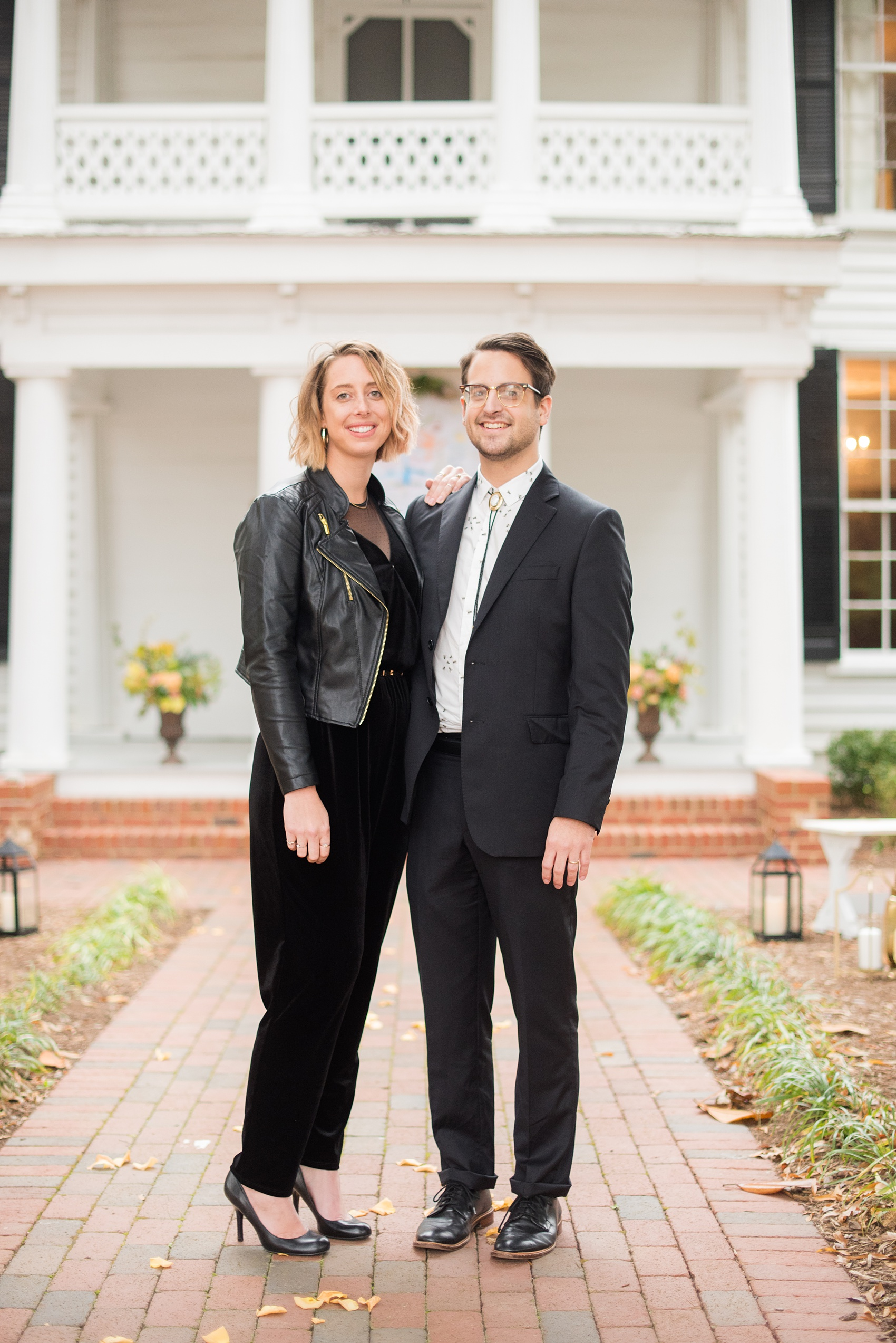 Mikkel Paige Photography photos from a wedding at Leslie-Alford Mims House in North Carolina. Picture of two trendy guests.