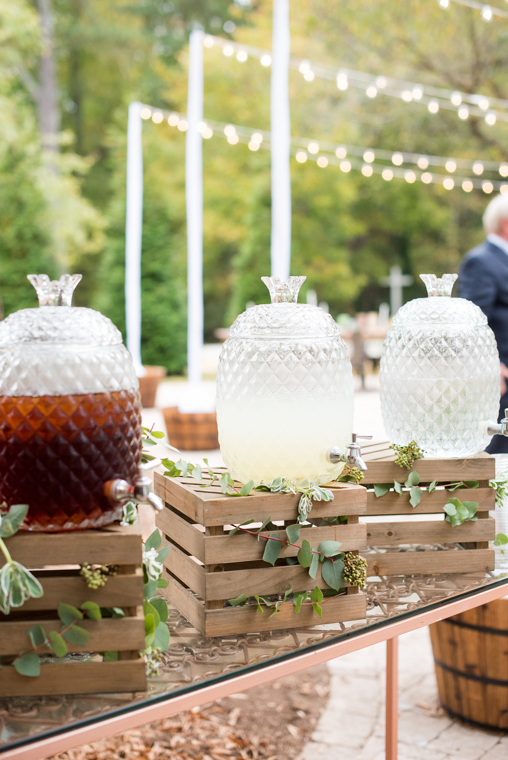 Mikkel Paige Photography photos from a wedding at Leslie-Alford Mims House in North Carolina. Picture of the stylized catering drinks on wooden crates for the boho event.