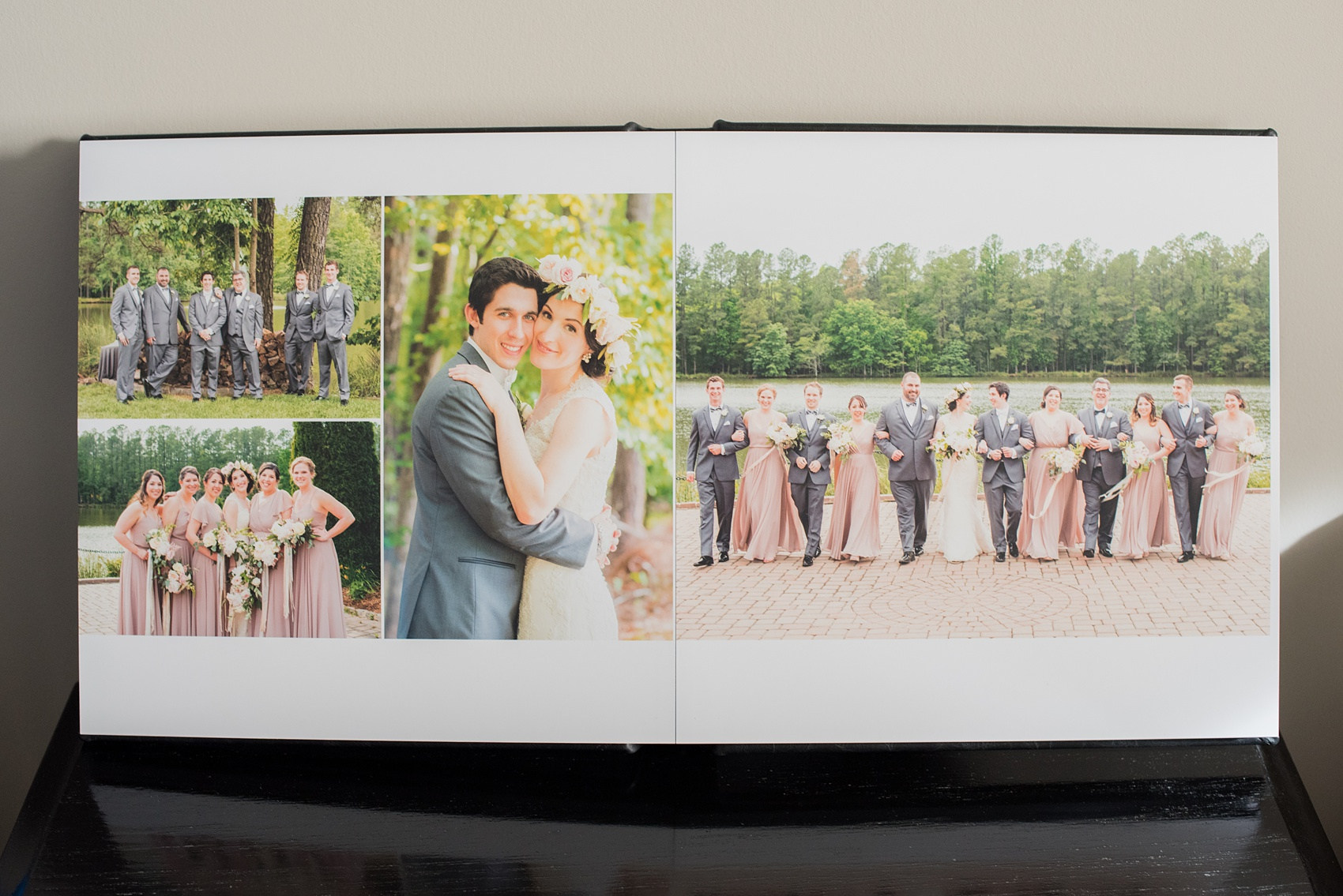 Images of a black calf leather fine art wedding album from Mikkel Paige Photography, a Raleigh, NC photographer. Photo shows a beautiful layout of the bride, groom and wedding party at The Pavilion at Angus Barn.