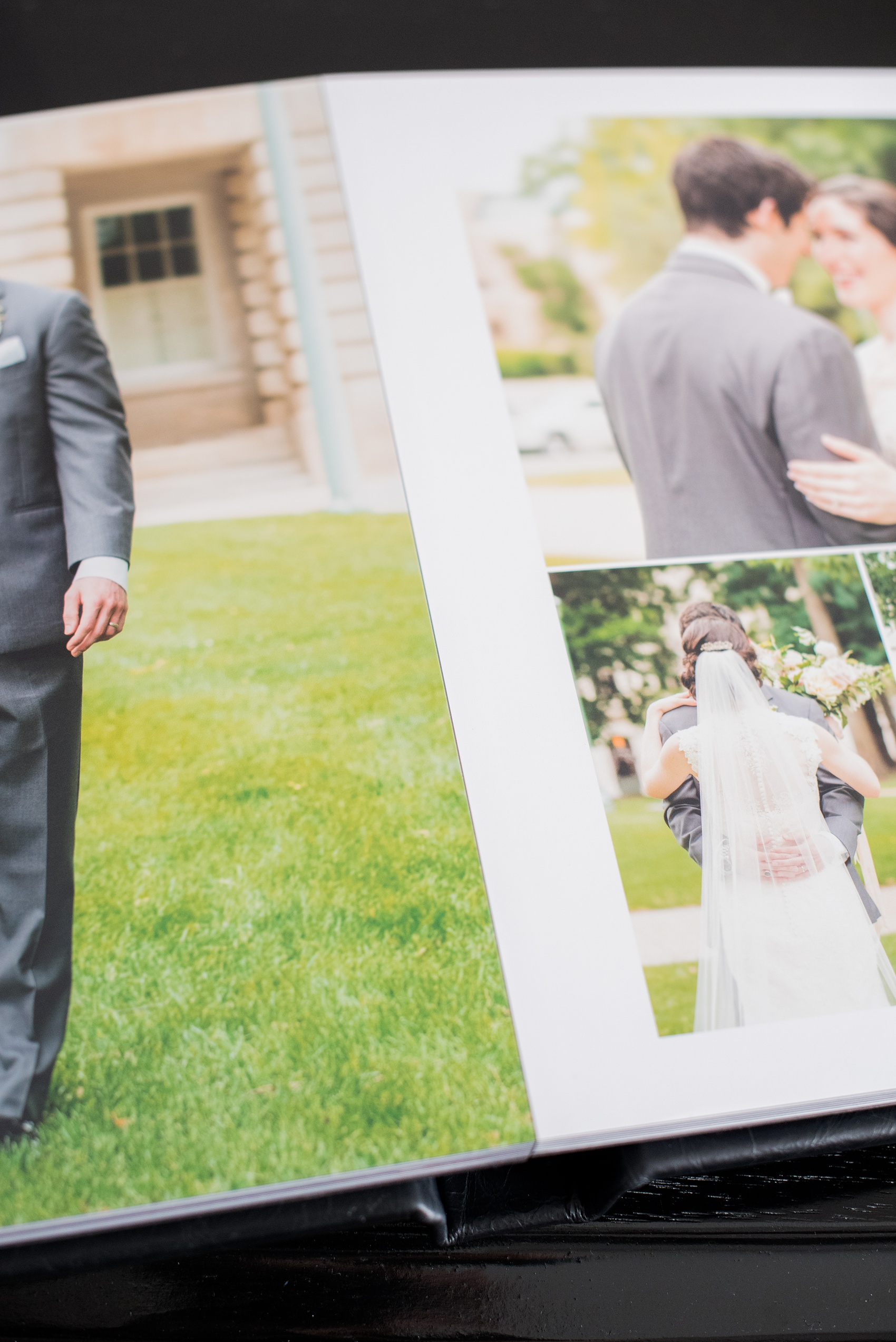 Images of a black calf leather fine art wedding album from Mikkel Paige Photography, a Raleigh, NC photographer. Photo shows the small distance in the gutter of the images.