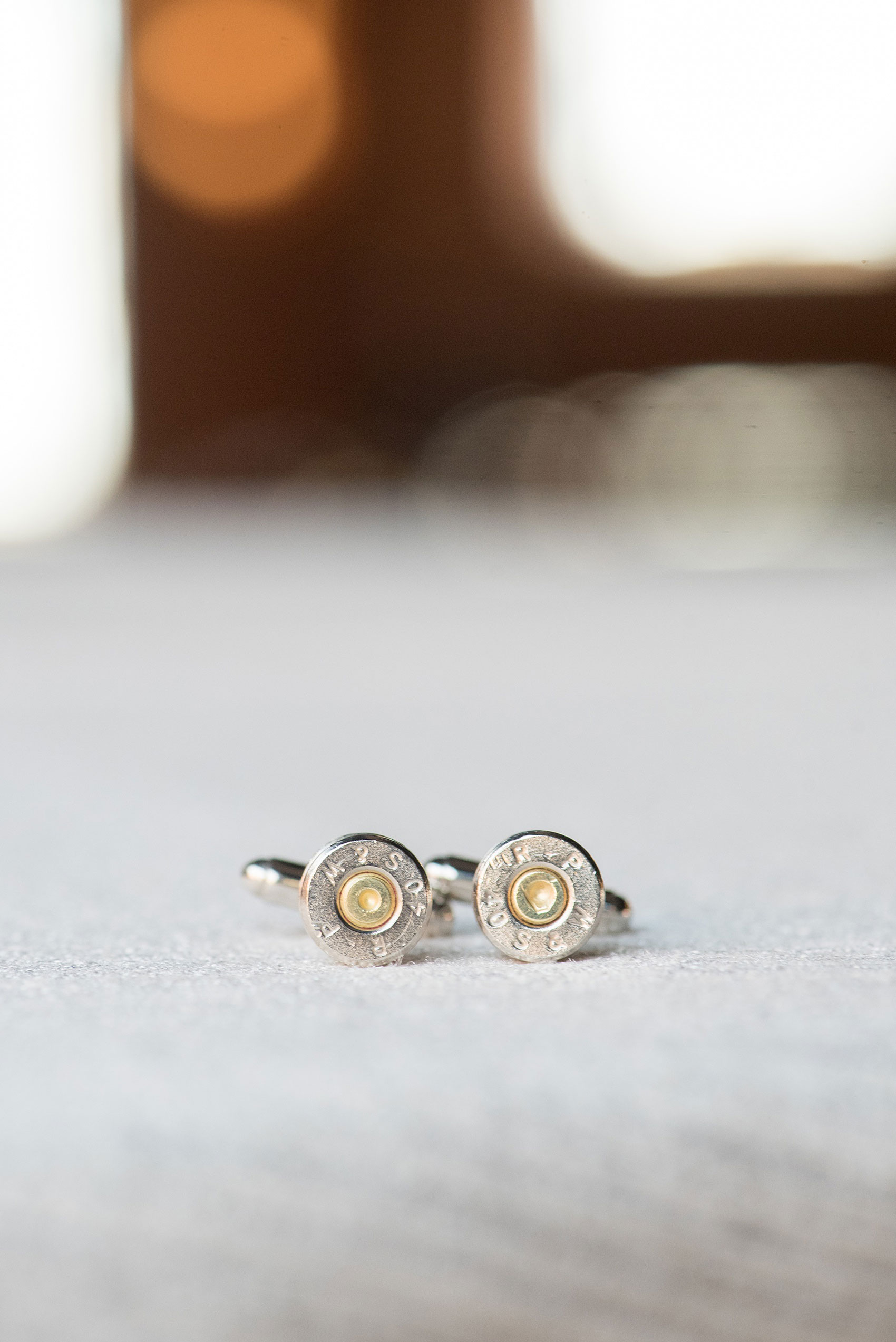 Durham wedding photos at The Cookery by Mikkel Paige Photography in North Carolina. The groomsmen wore a detail of bullet cufflinks, all police officers and some ex-military friends of the groom.