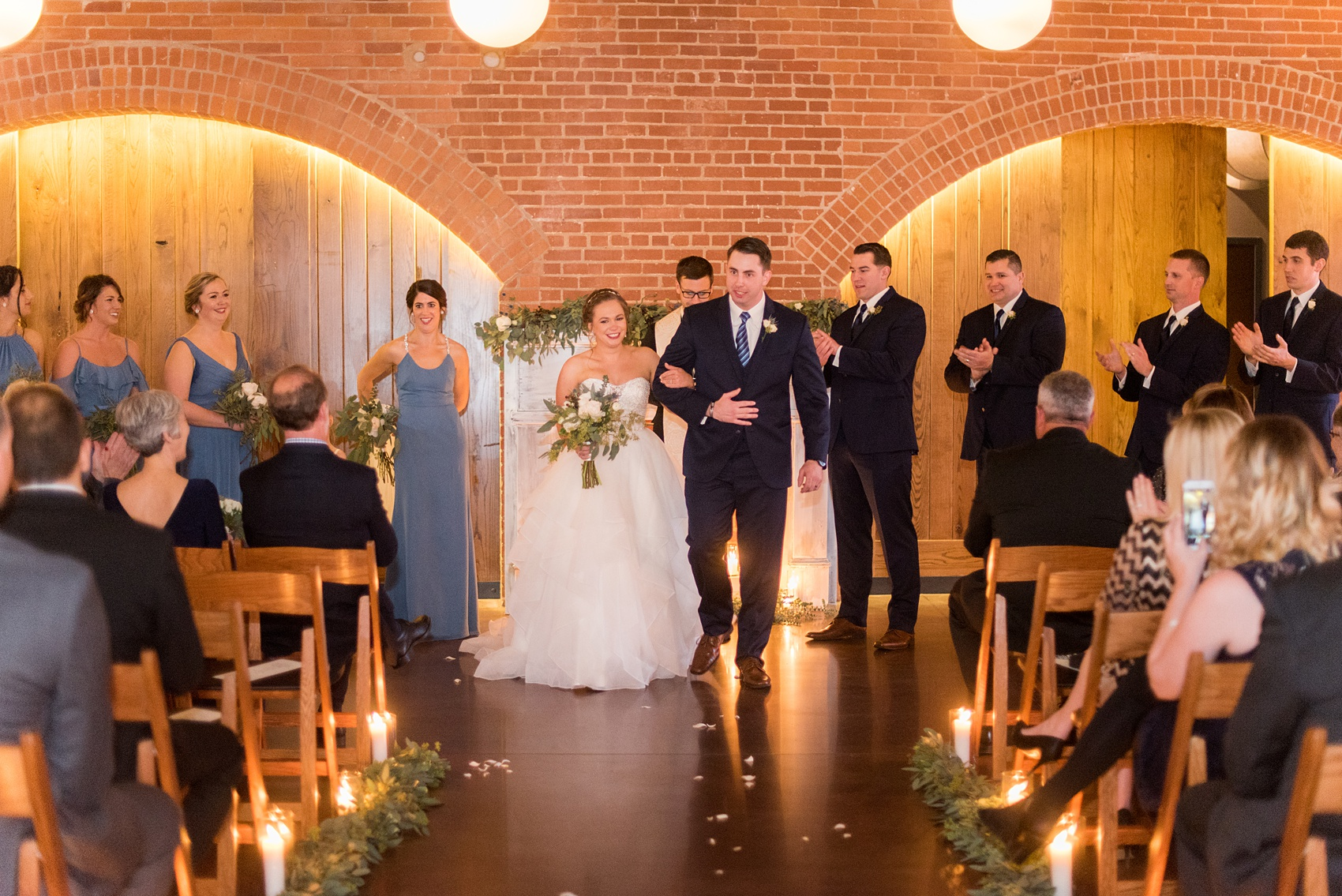 Durham wedding photos at The Cookery by Mikkel Paige Photography in North Carolina. The bride and groom got married in a romantic indoor ceremony during their winter wedding.