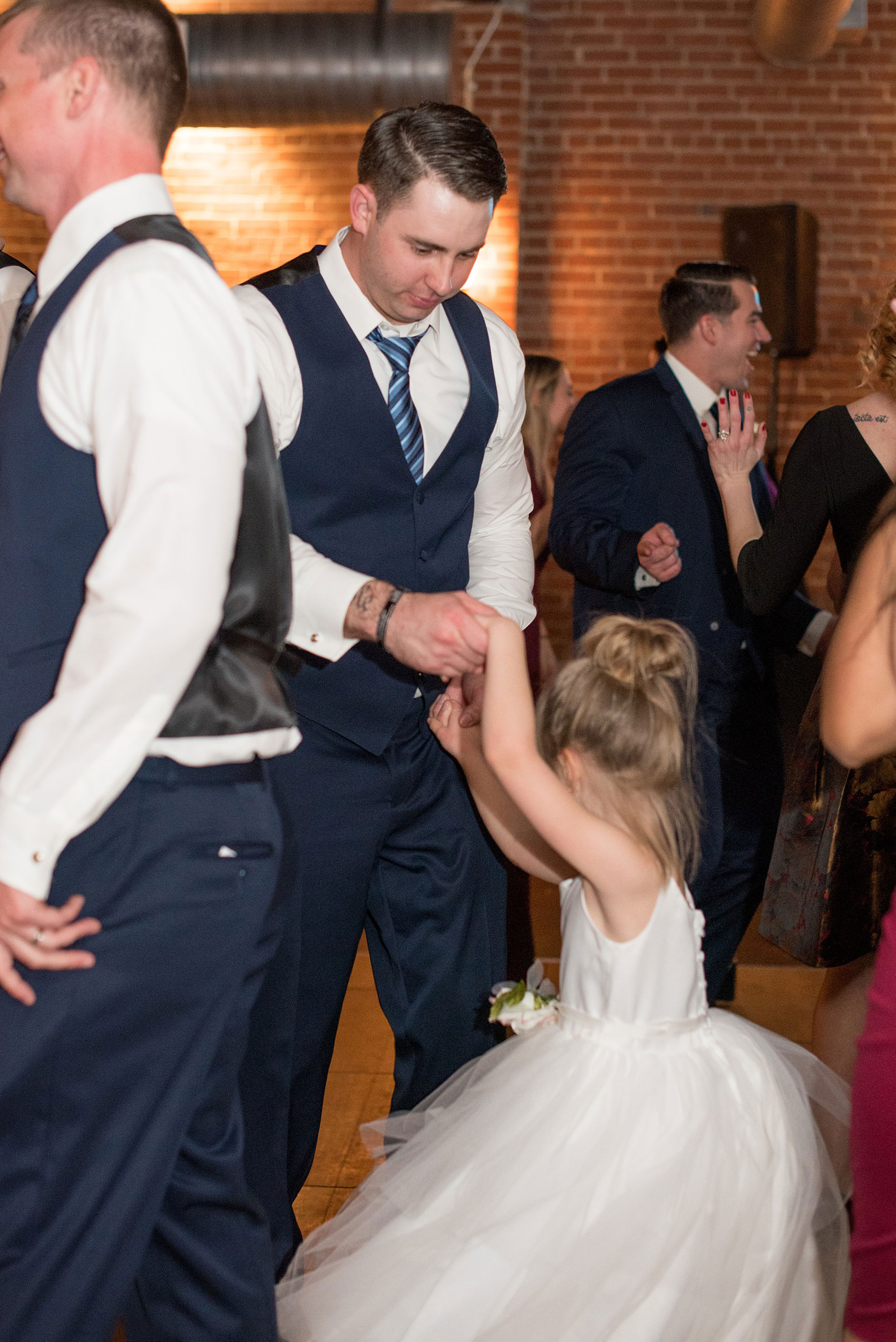 Durham wedding photos at The Cookery by Mikkel Paige Photography in North Carolina. The groom danced with his daughter, the flower girl, during the winter reception.