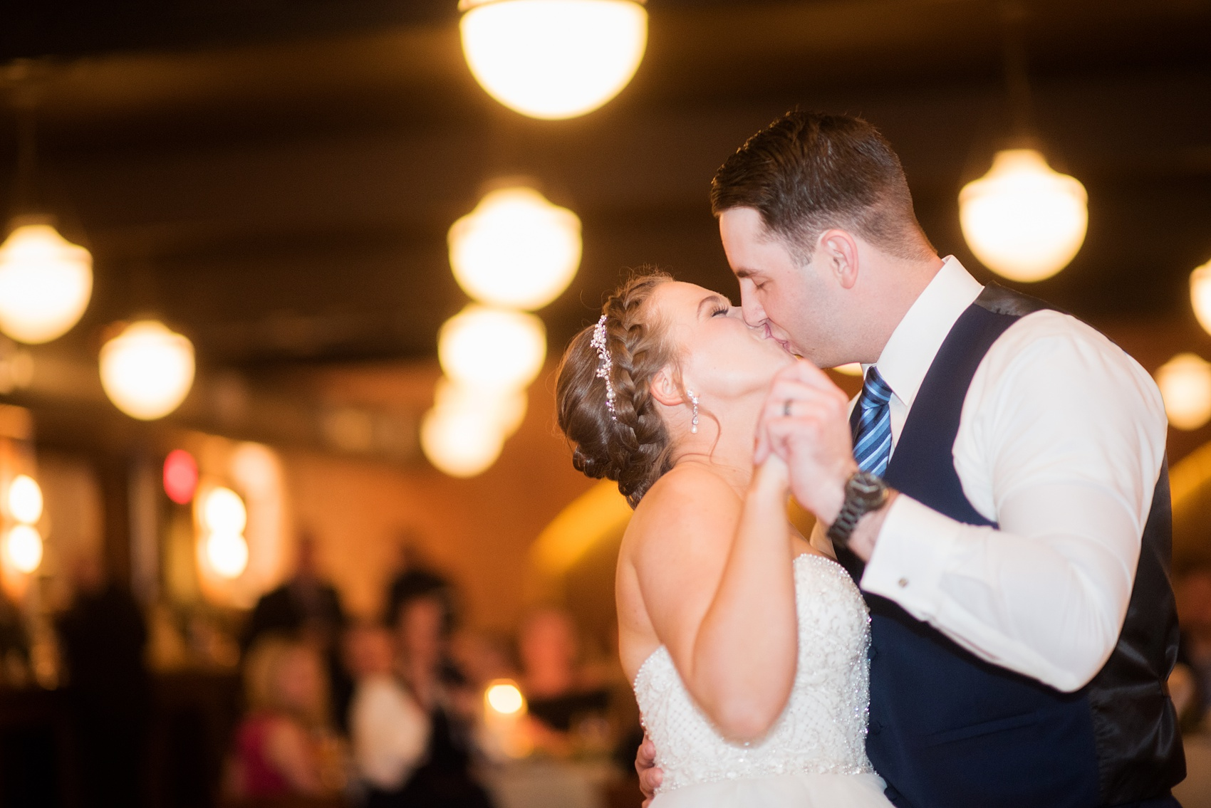 Durham wedding photos at The Cookery by Mikkel Paige Photography in North Carolina. The bride and groom kiss during their first dance.