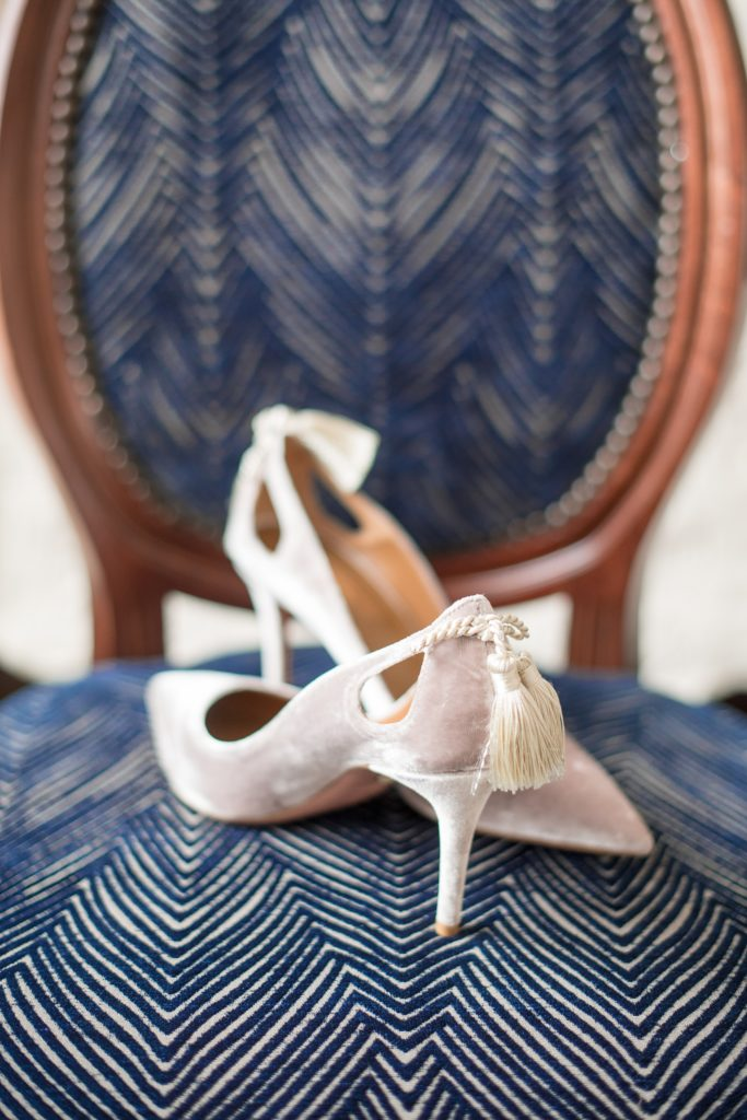 Wedding photos at Sleepy Hollow Country Club for a winter reception in January by Mikkel Paige Photography. The couple's Pittsburgh friends all contributed to a cookie table as dessert for the reception. Picture of the bride's Italian taupe velvet bridal heels by Aquazzura Firenze.