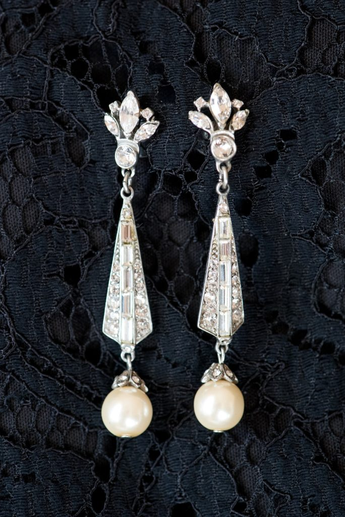 Wedding photos at Sleepy Hollow Country Club for a winter reception in January by Mikkel Paige Photography. A detail picture of the bride's vintage diamond and pearl earrings.