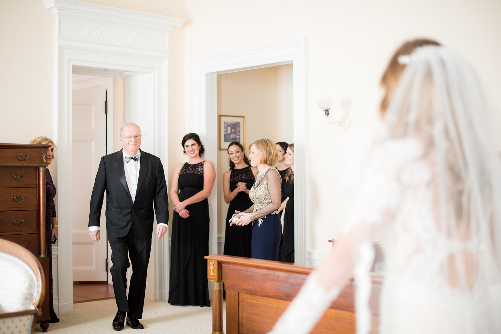 Wedding photos at Sleepy Hollow Country Club for a winter reception in January by Mikkel Paige Photography. A picture of the bride's father seeing her for the first time that day.