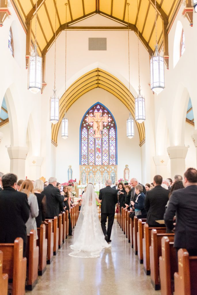 Wedding photos at Sleepy Hollow Country Club for a winter reception in January by Mikkel Paige Photography. A picture of the bride's father walking her down the aisle during their small church ceremony in New York.